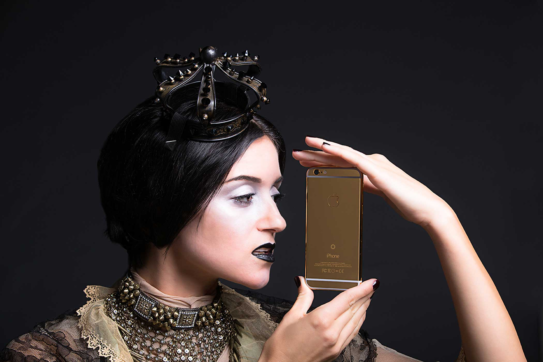 A model gazes sadly at the Lux iPhone 6s in 24-karat yellow gold, the diamond-less and cheapest option among the 5.5 -screen devices ($8,995).