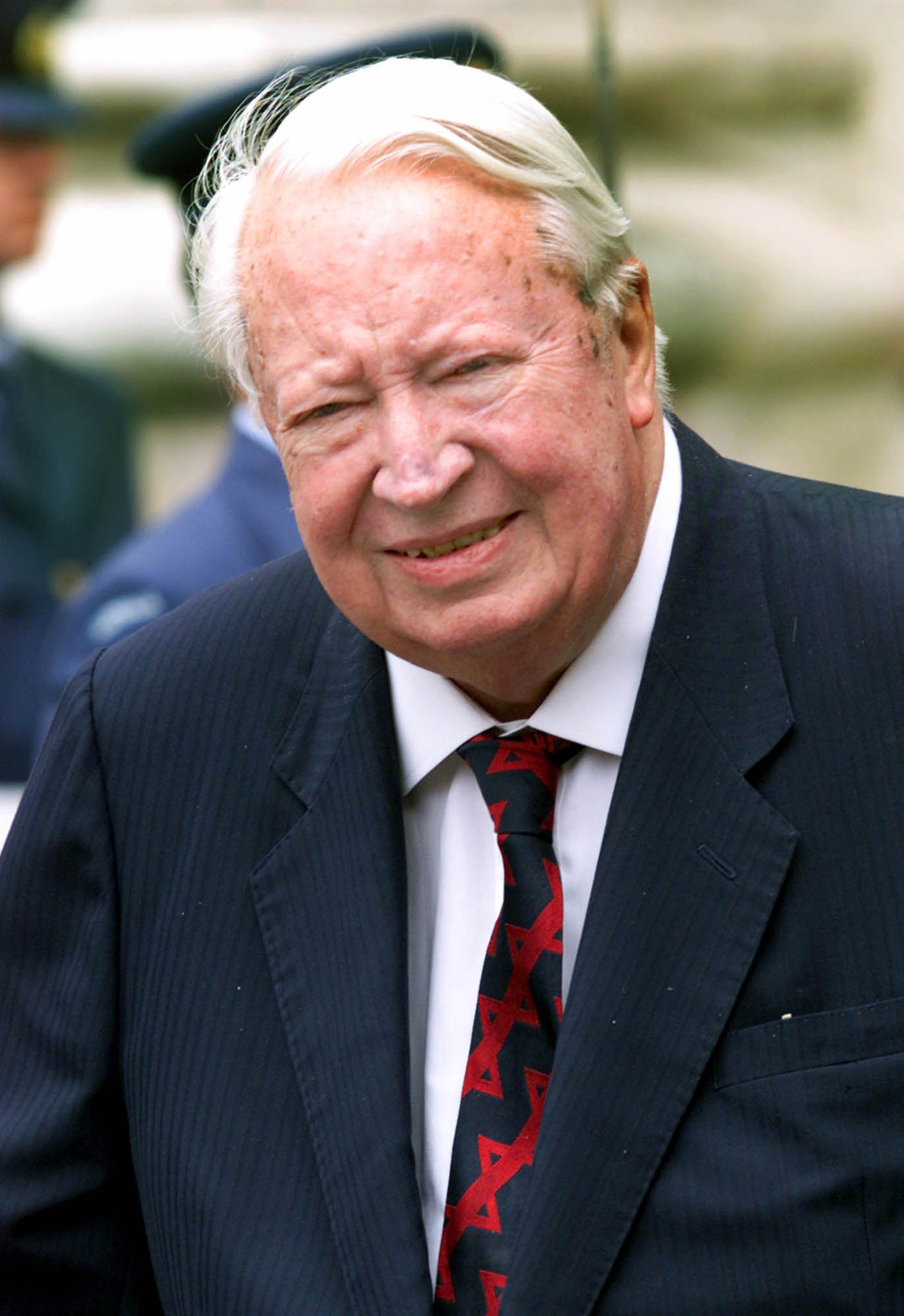Edward Heath, former British Prime Minister, leaves Westminster Abbey after a service to mark the centenary of modern Australia on July 7, 2000.