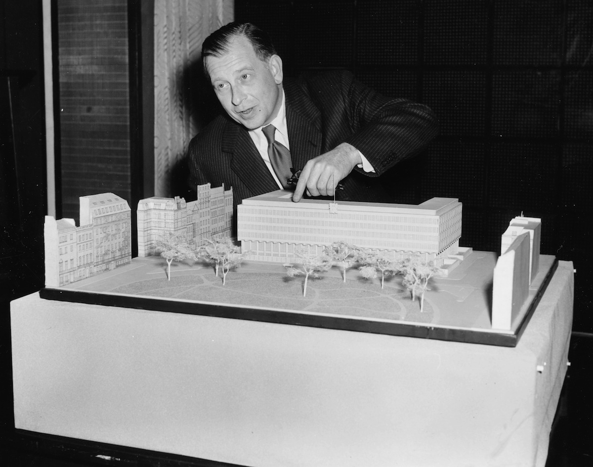 Architect Eero Saarinen with the model of the new proposed US Embassy in London, June 5, 1956.