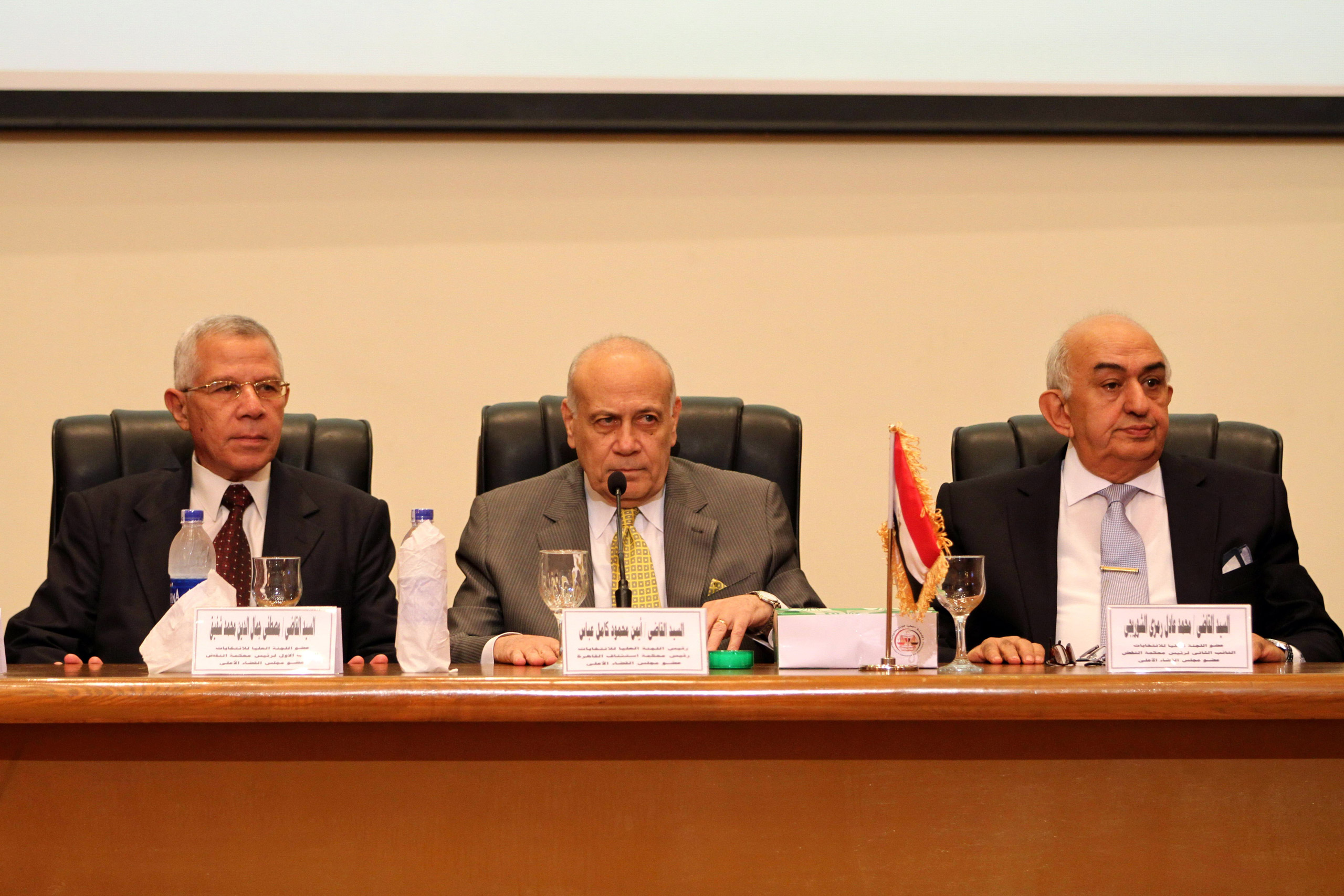 Ayman Abbas, center, head of the Supreme Election Committee, announces the dates for Egypt's parliamentary elections at a news conference in Cairo, on Aug. 30, 2015.