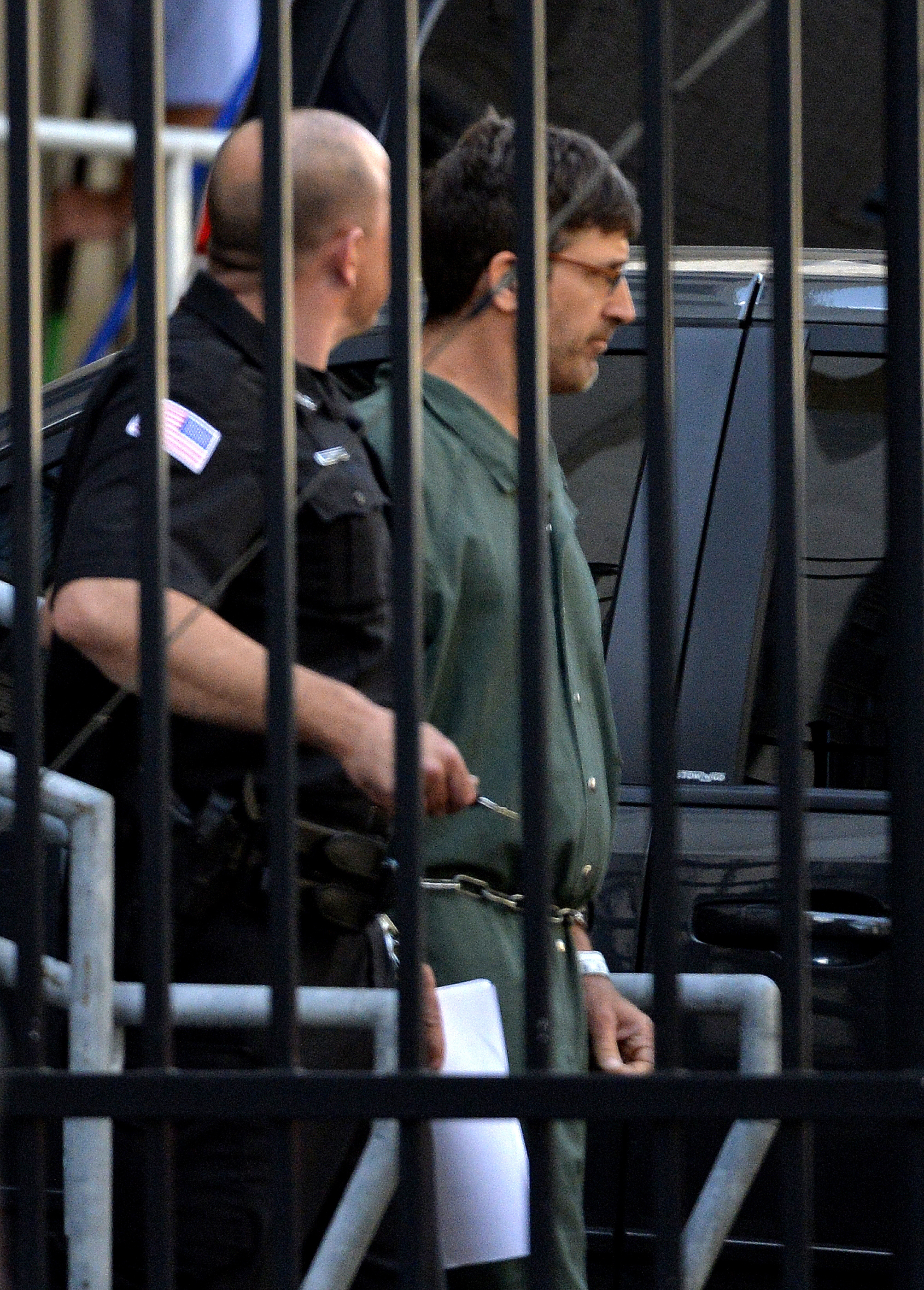 Glendon Scott Crawford, 49, of Galway, N.Y., leaves the federal courthouse in shackles after being arraigned on June 19, 2013, in Albany, N.Y.