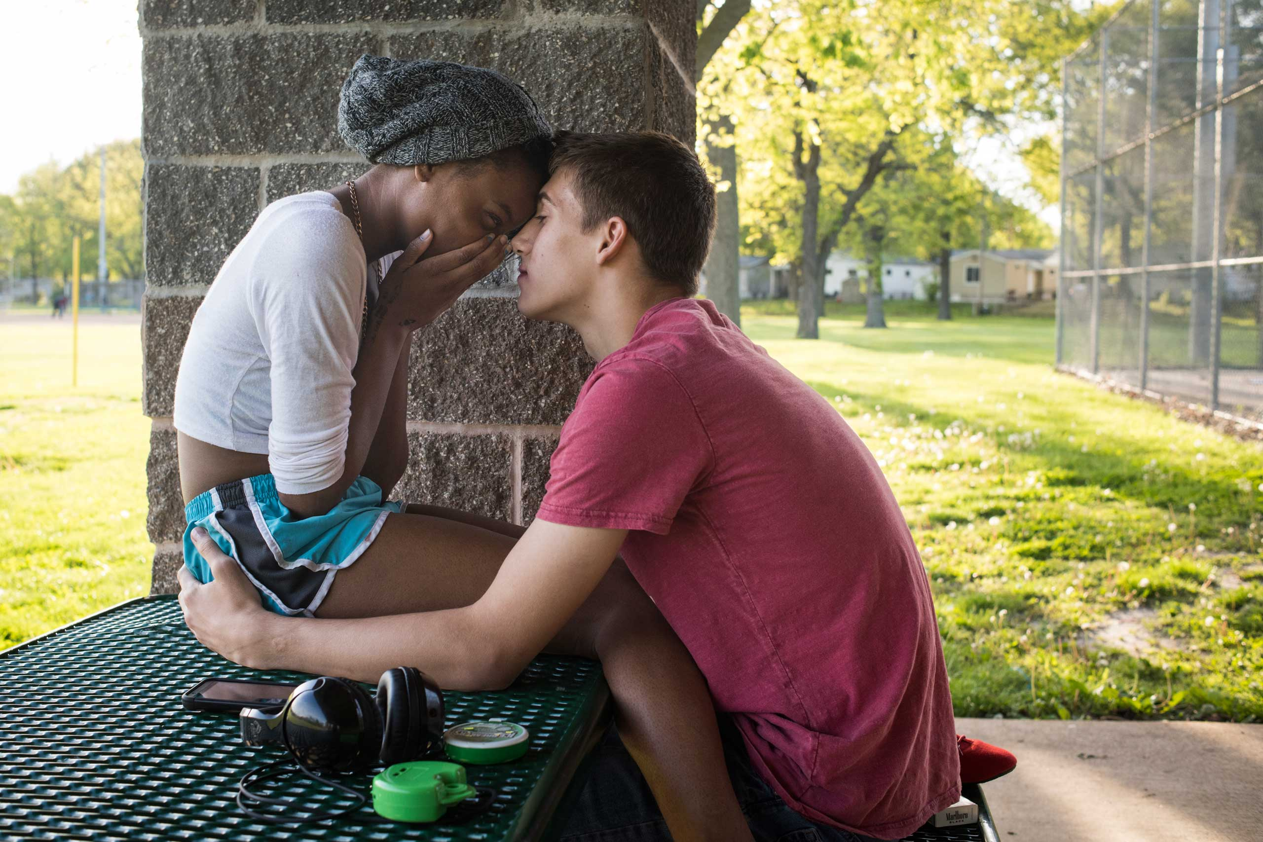 Grace Williams, a high school freshman from Ferguson, kisses Patrick Clinton, a sophomore, while at Forestwood Park. The two had been flirting for a few weeks but hadn't quite figured out if they were officially dating.