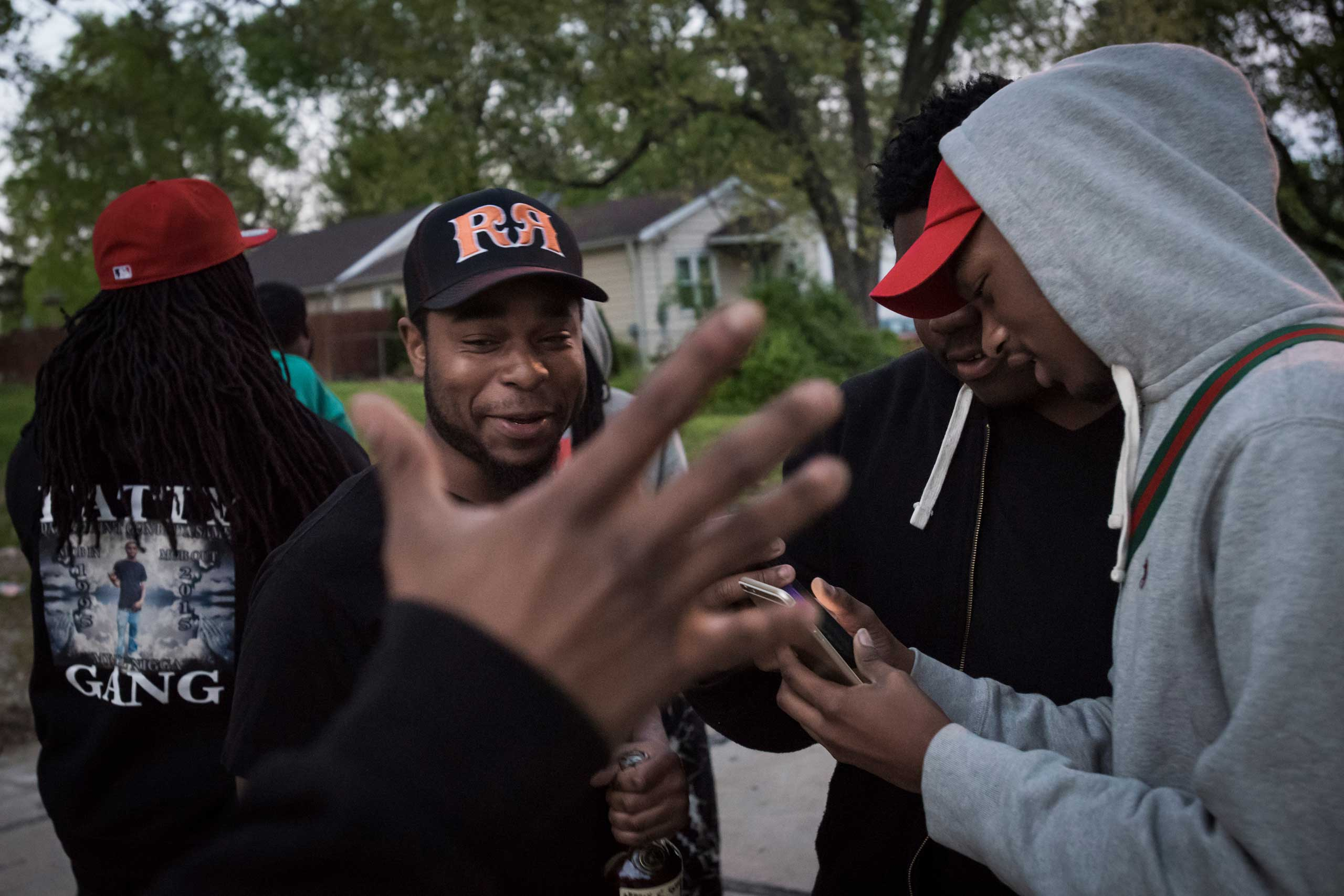 "Meech greets a friend while hanging out in the Bermuda neighborhood of Ferguson, Mo. Their group calls themselves Fatty Gang, named after their friend, 20 year-old Antwon ""Fatty"" Smith, who was shot to death in February, 2015."