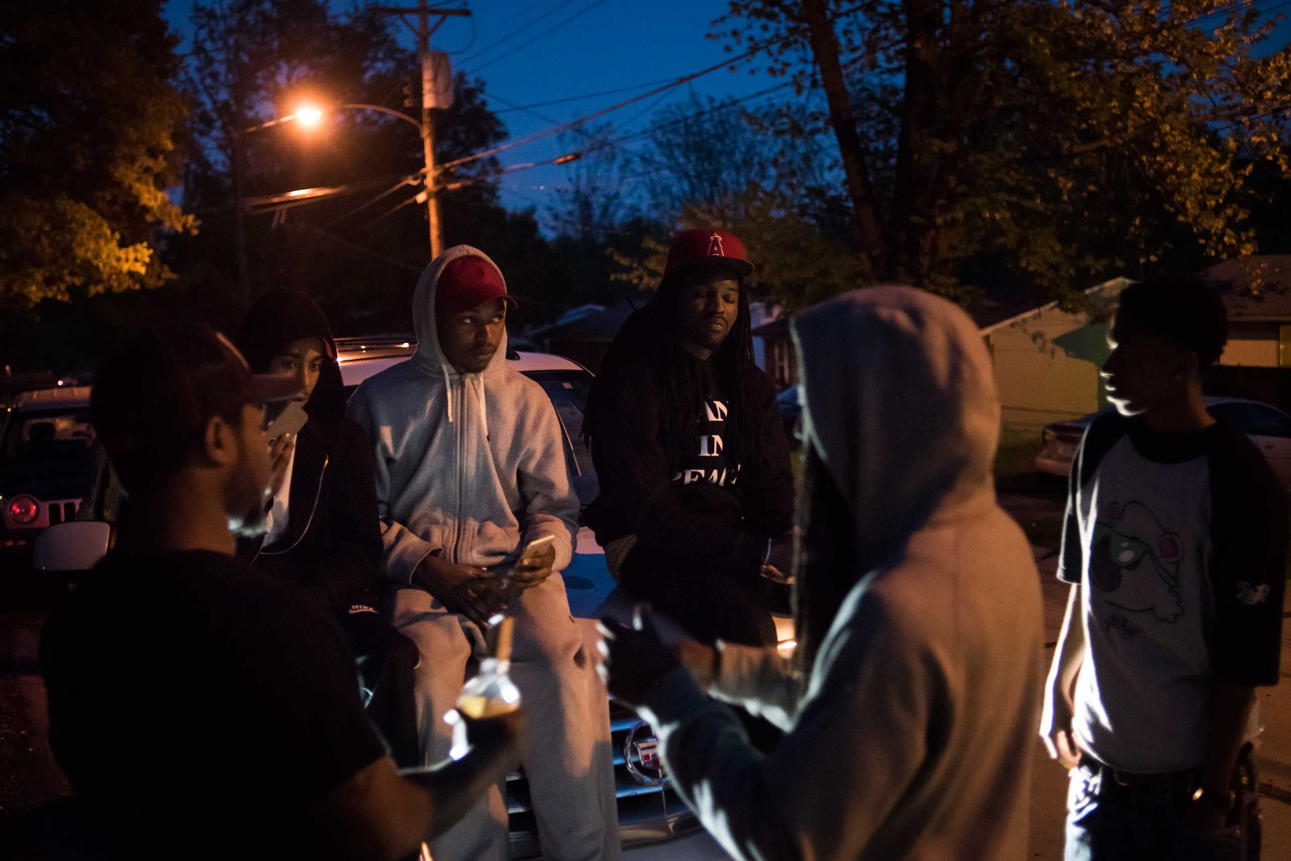 "A group of friends hang out on Halpin Drive, just down the street from where their friend Demetrius ""Trap"" Stegall was shot and killed in 2009. They call this area ""Trapville,"" in memory of their friend."