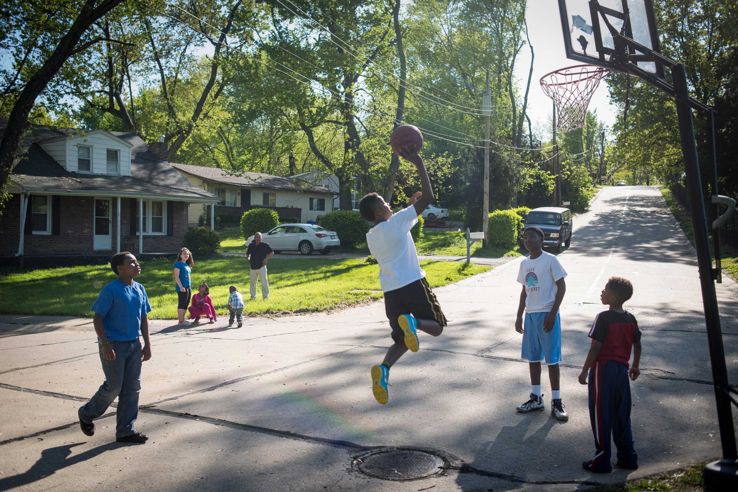 Kids play basketball on the corner of Halpin Drive and Lagonda Avenue where a young man named Demetrius  Trap  Stegall was killed in 2009. Trap was involved in a robbery and after a large group argument earlier that day, an associate of the person who was robbed returned to the corner and opened fire.