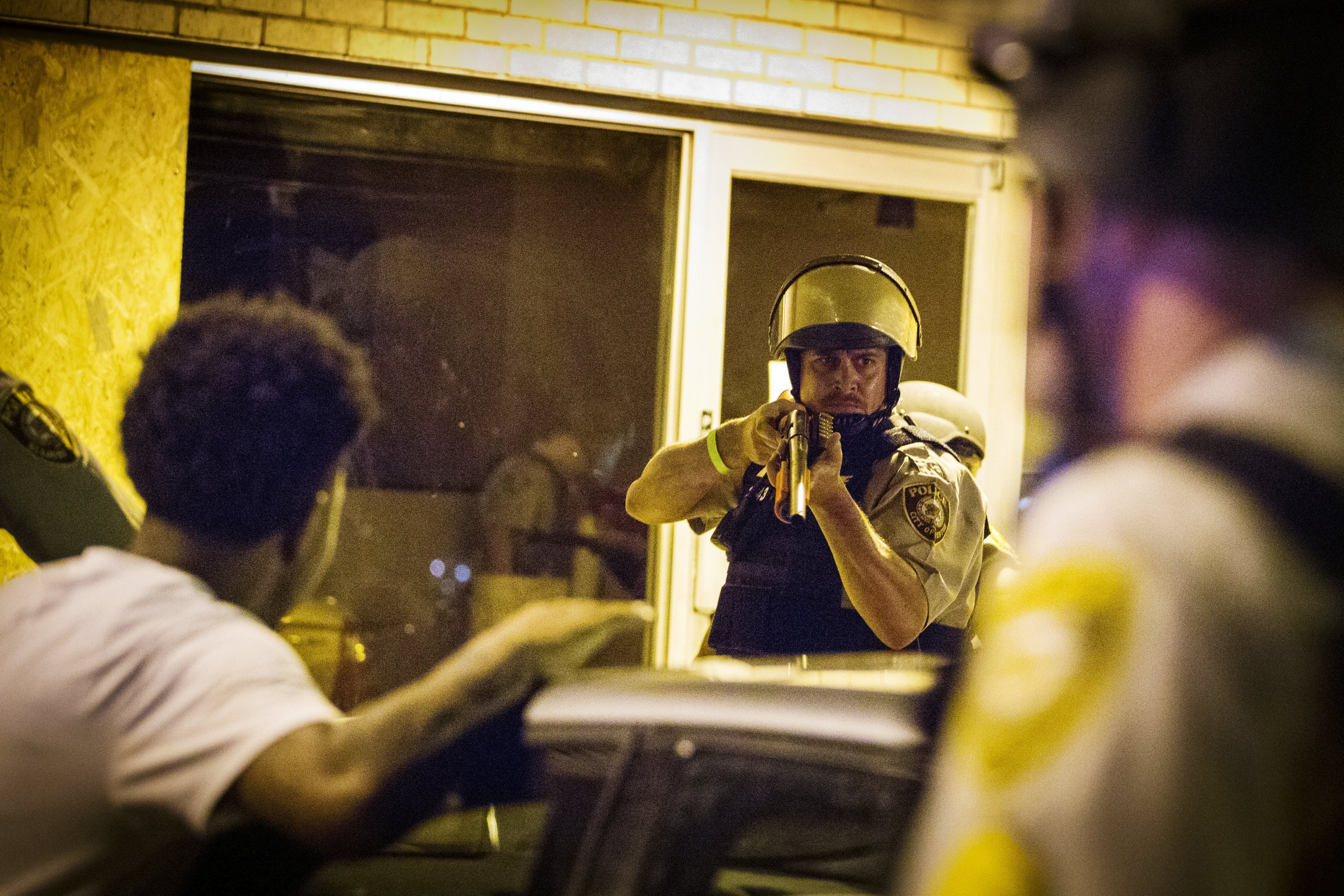 St Louis County police officers arrest an anti-police demonstrator in Ferguson, Mo. on Aug. 11, 2015.