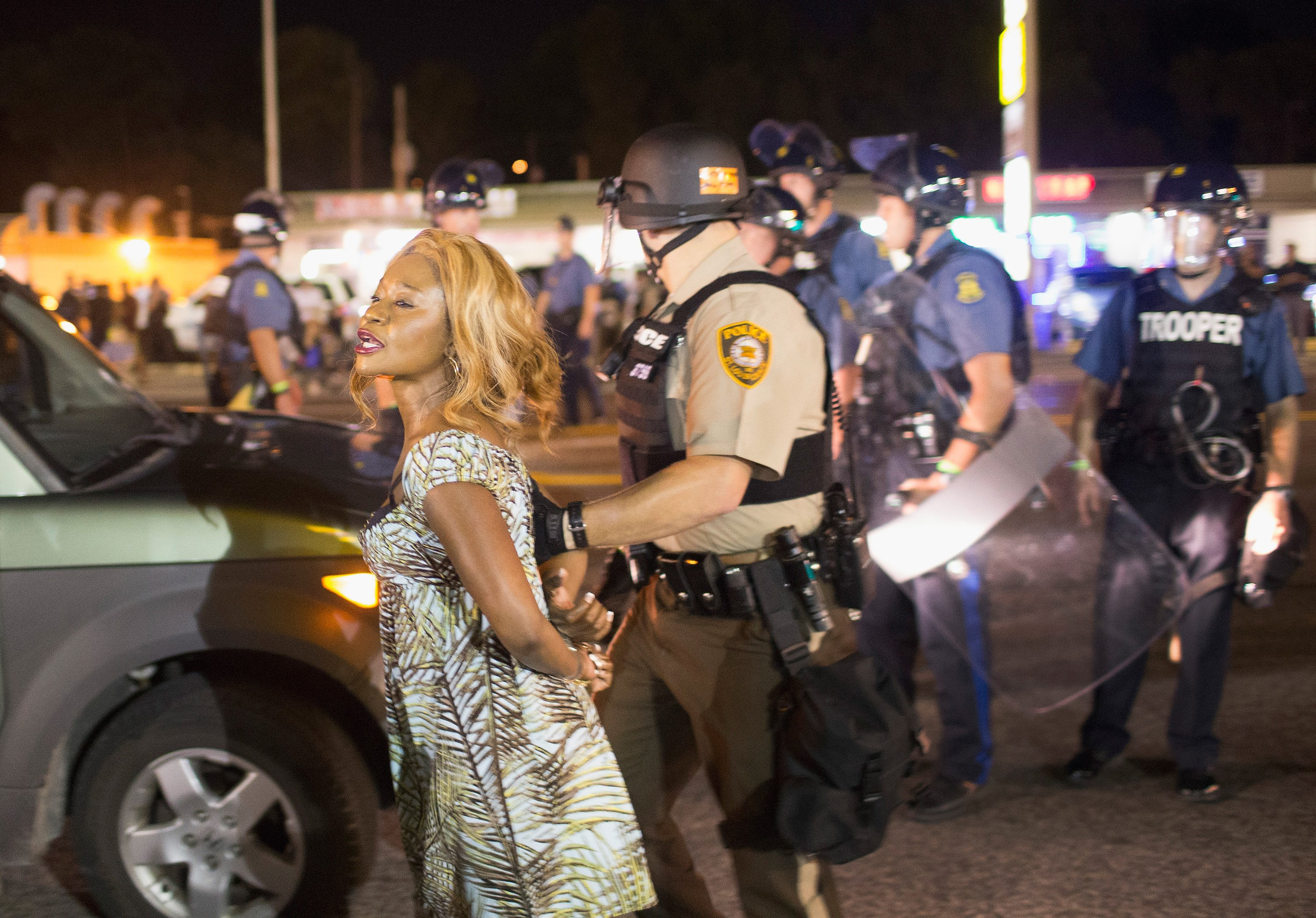A demonstrator is arrested during a protest marking the one-year anniversary of the shooting of Michael Brown along West Florrisant Street on Aug. 10, 2015 in Ferguson, Mo.