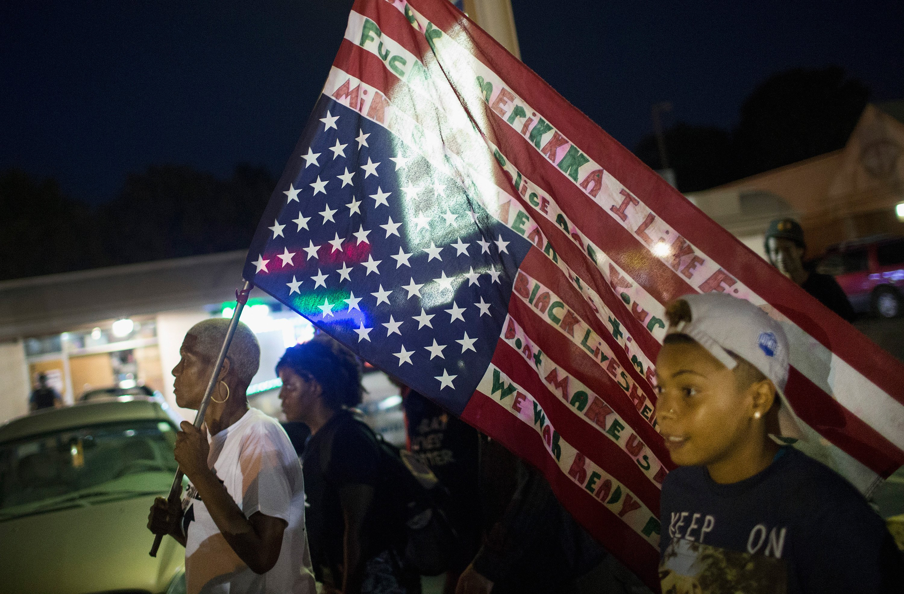 Demonstrators, marking the one-year anniversary of the shooting of Michael Brown, protest along West Florrisant Street on Aug. 10, 2015 in Ferguson, Mo.