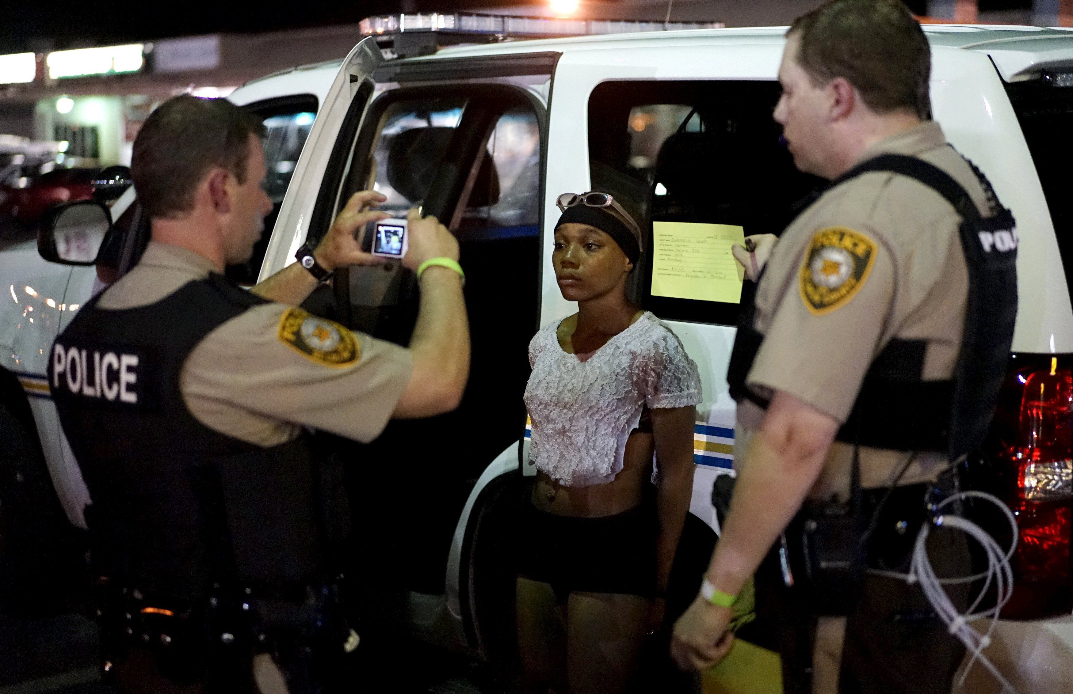Police take a mug shot of a protester who was detained in Ferguson, Mo. on Aug. 10, 2015.