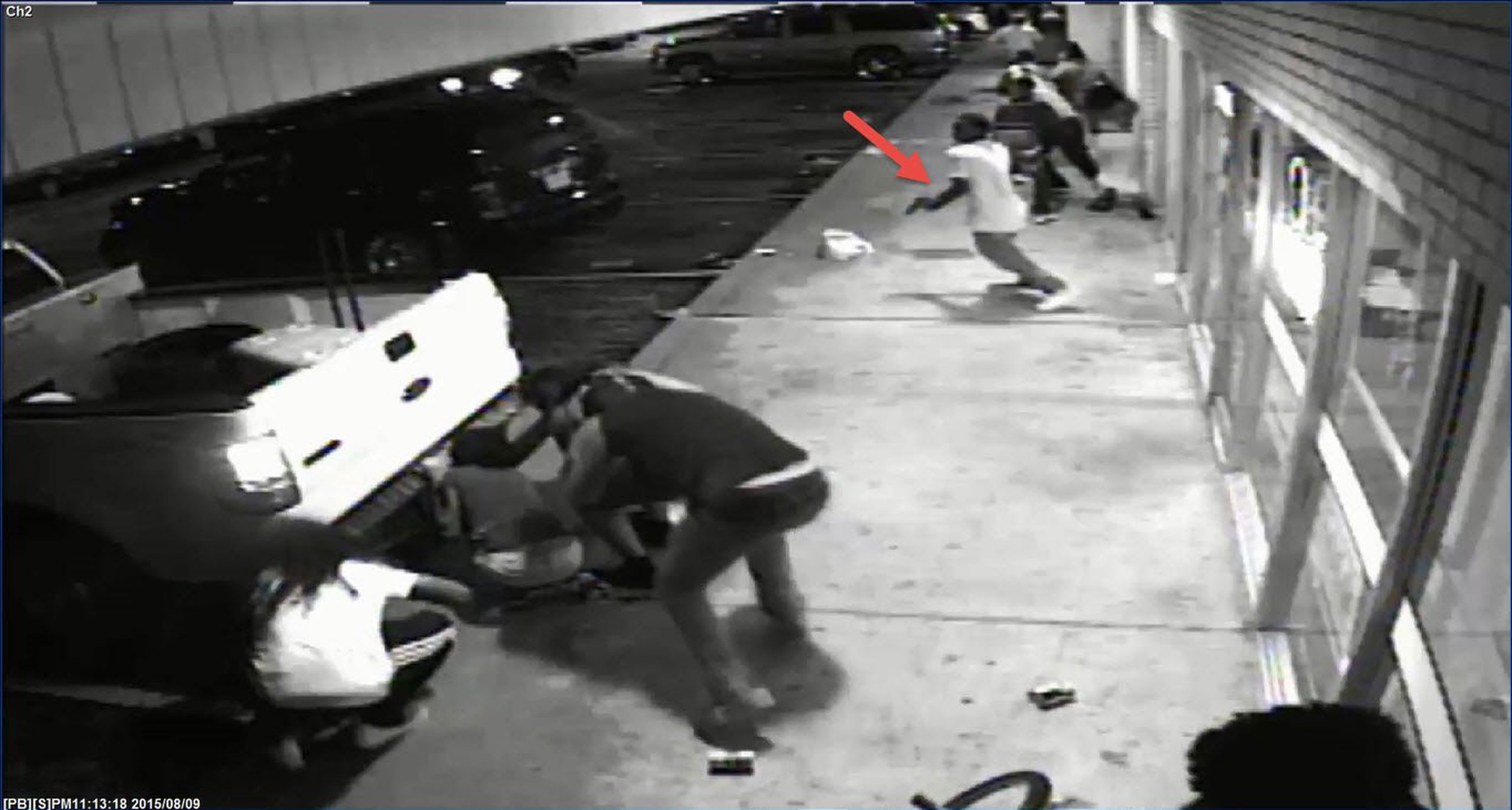 In this handout provided by the St. Louis County Police Department, video surveillance appears to show Tyrone Harris Jr. grab a handgun once shots are fired during the protest in the W. Florissant corridor, prior to the officer involved shooting in St. Louis, Mo., on August 9, 2015 .