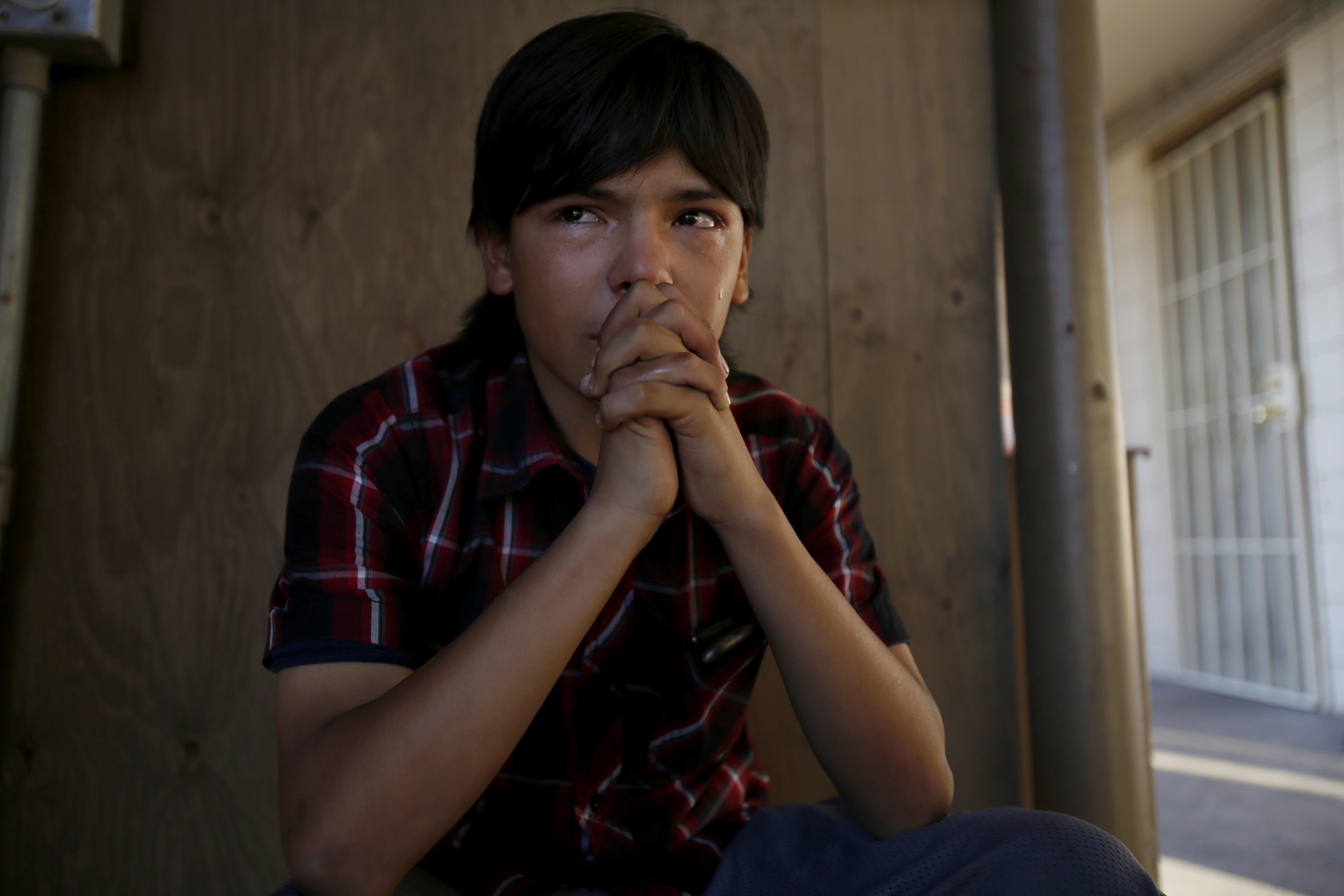 The Los Angeles Times: No room at the inn for innocenceEddie Martinez, 14, sits crying in the stairwell.
