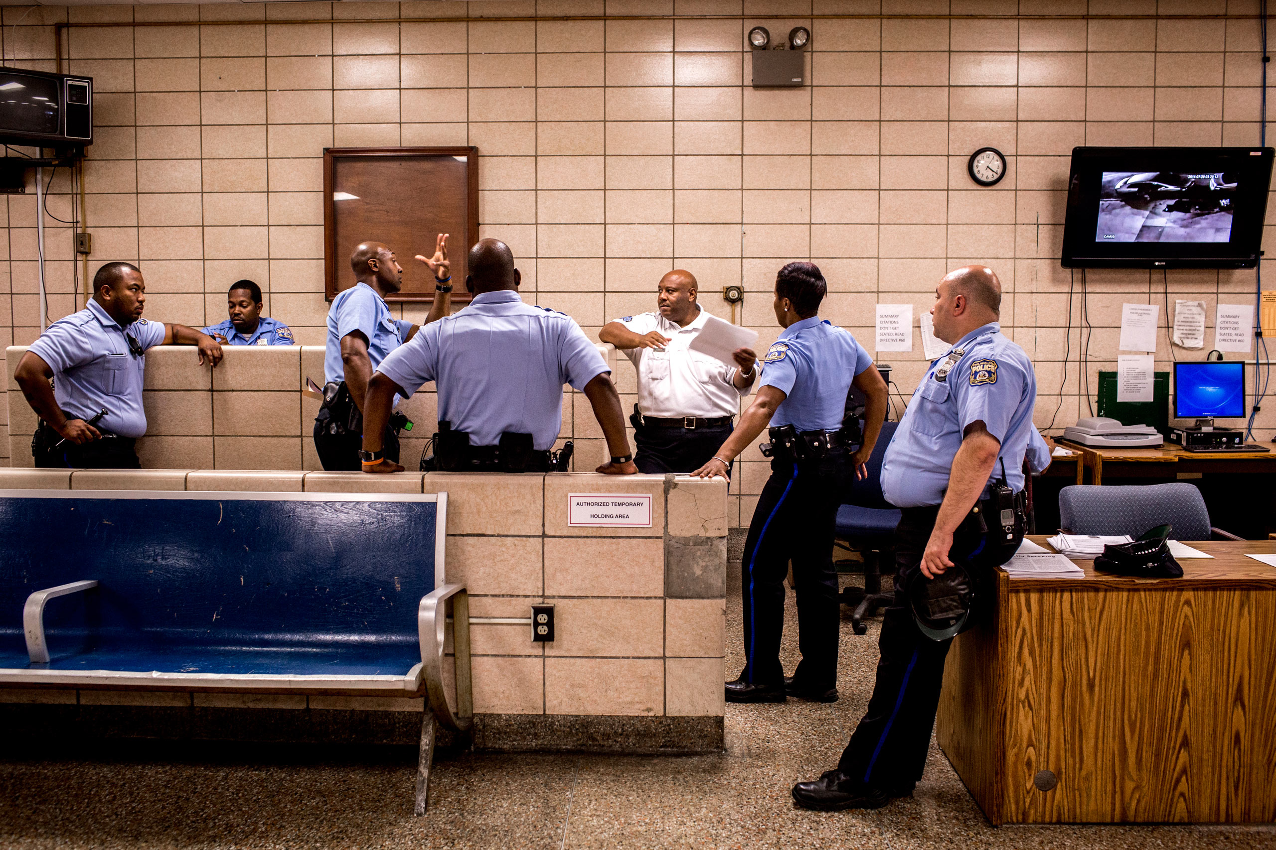 Sergeant Rodney Linder, center, speaks to a group of officers before they head out on patrol for the evening. July 27, 2015. Philadelphia, Pa.