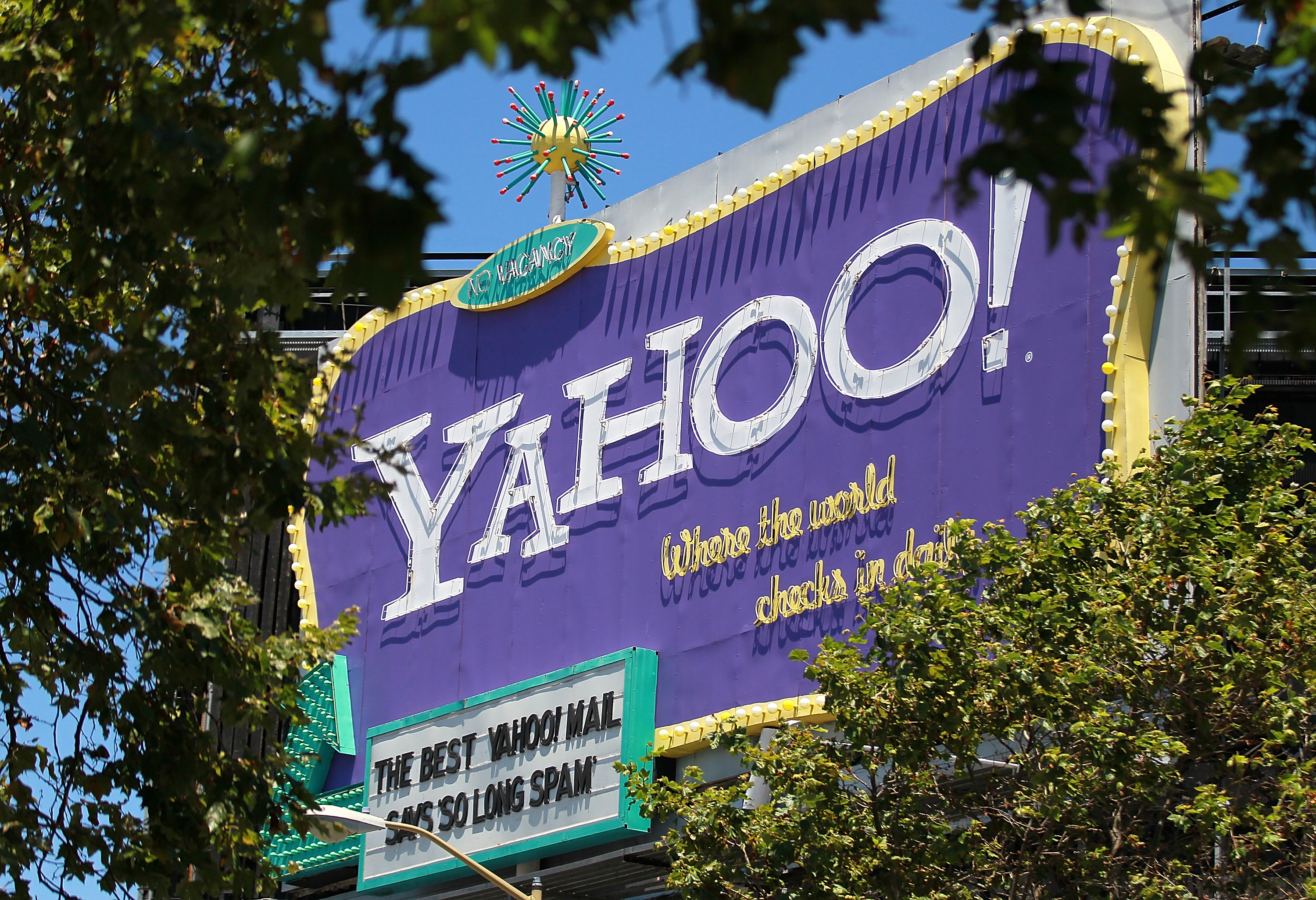 A  Yahoo! billboard is visible through trees on July 19, 2011 in San Francisco, California.