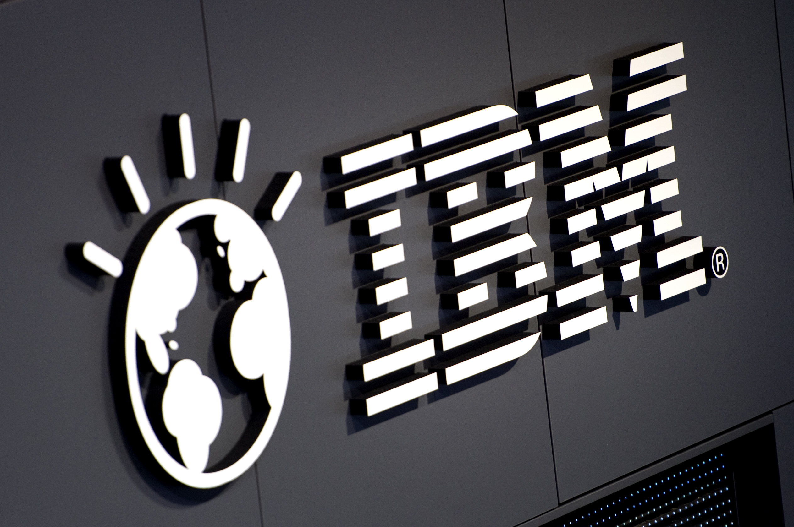 The logo of IBM is seen at their booth prior to the opening of the CeBIT IT fair on March 5, 2012 in Hanover, central Germany.