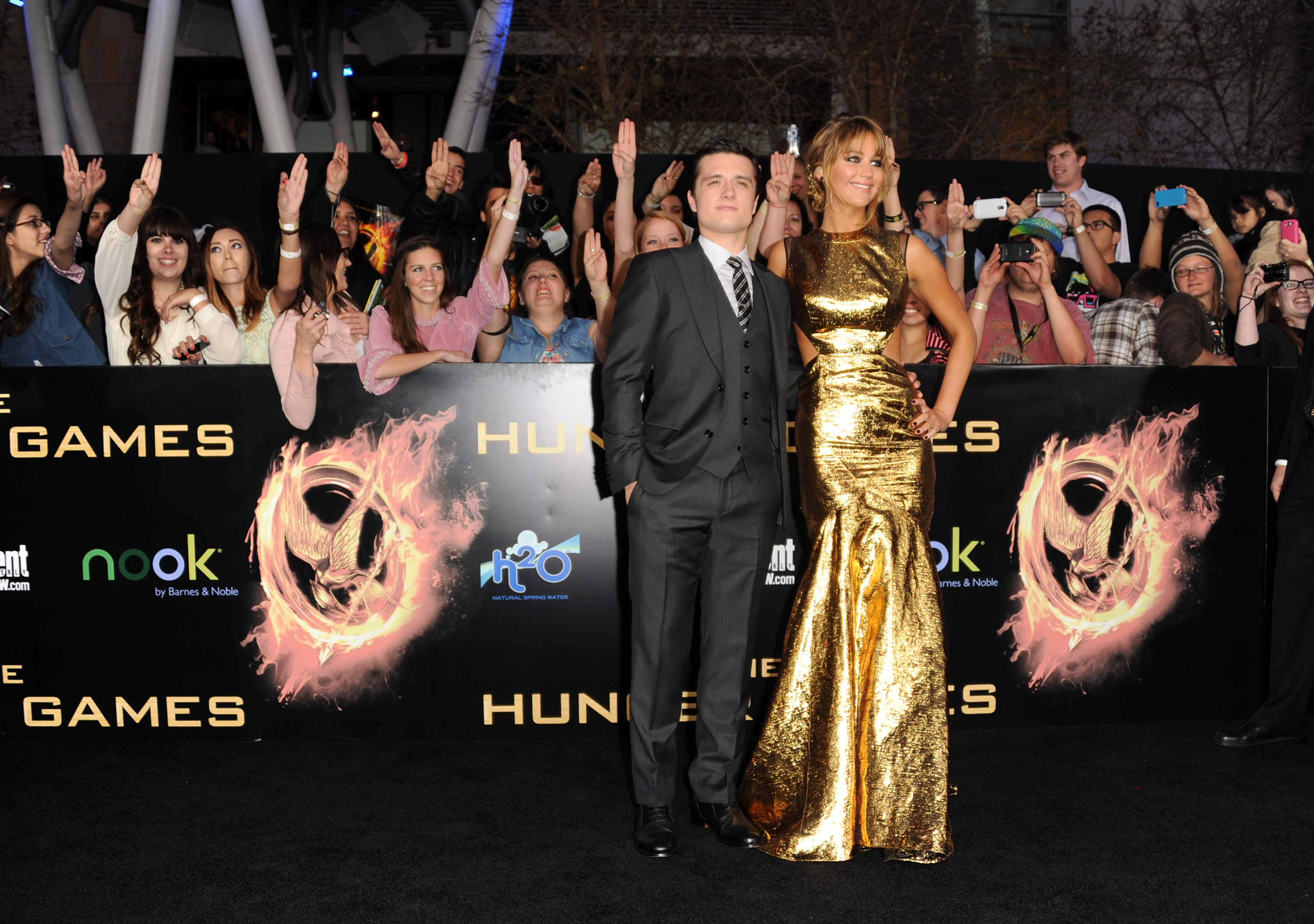 Josh Hutcherson and Jennifer Lawrence arrive at the premiere of <i>The Hunger Games</i> on March 12, 2012 in Los Angeles.