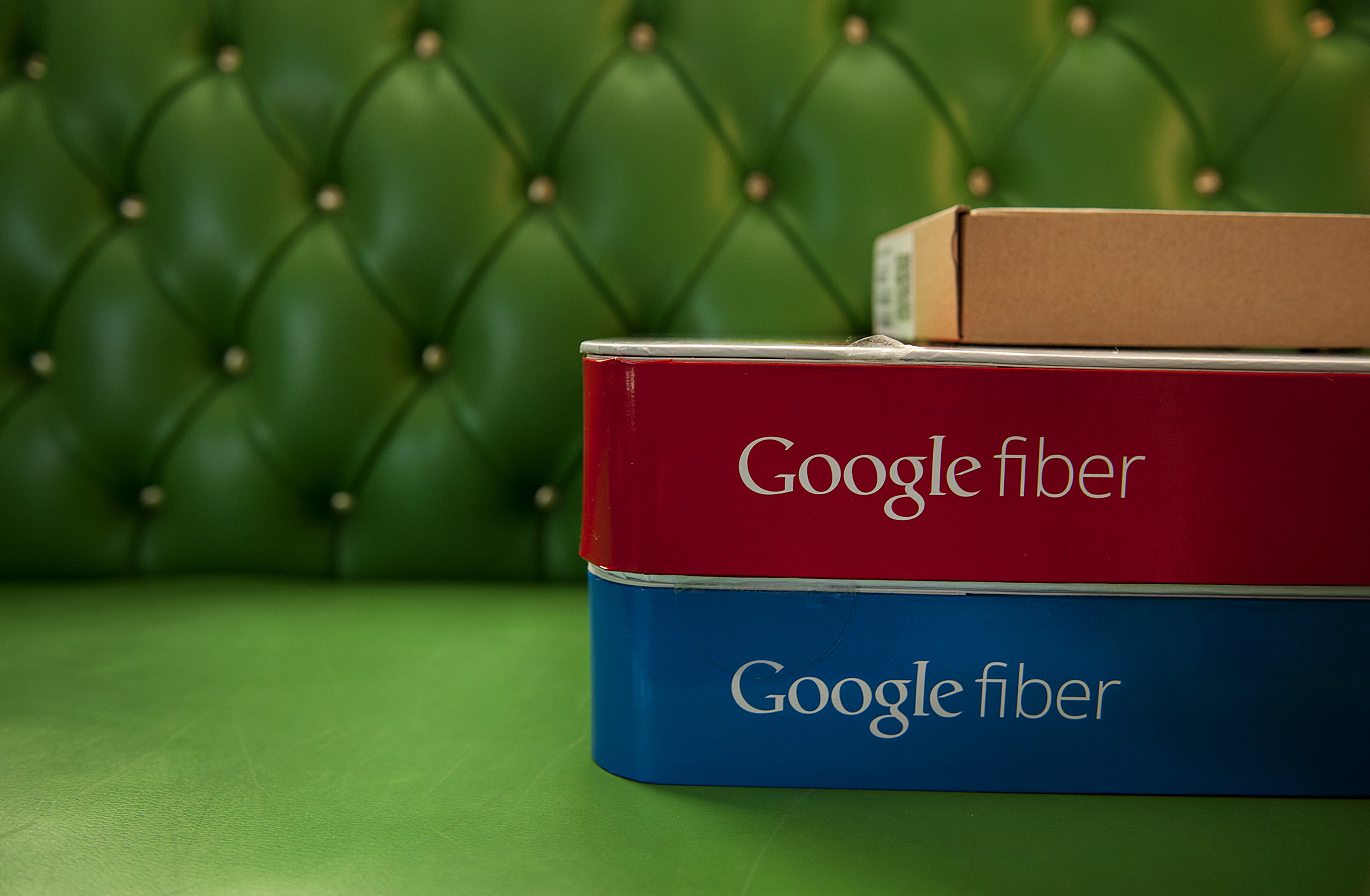 Boxes of equipment needed to install Google Fiber broadband network sit on a couch at the home of customer Becki Sherwood in Kansas City, Kansas, U.S., on Tuesday, Nov. 27, 2012.