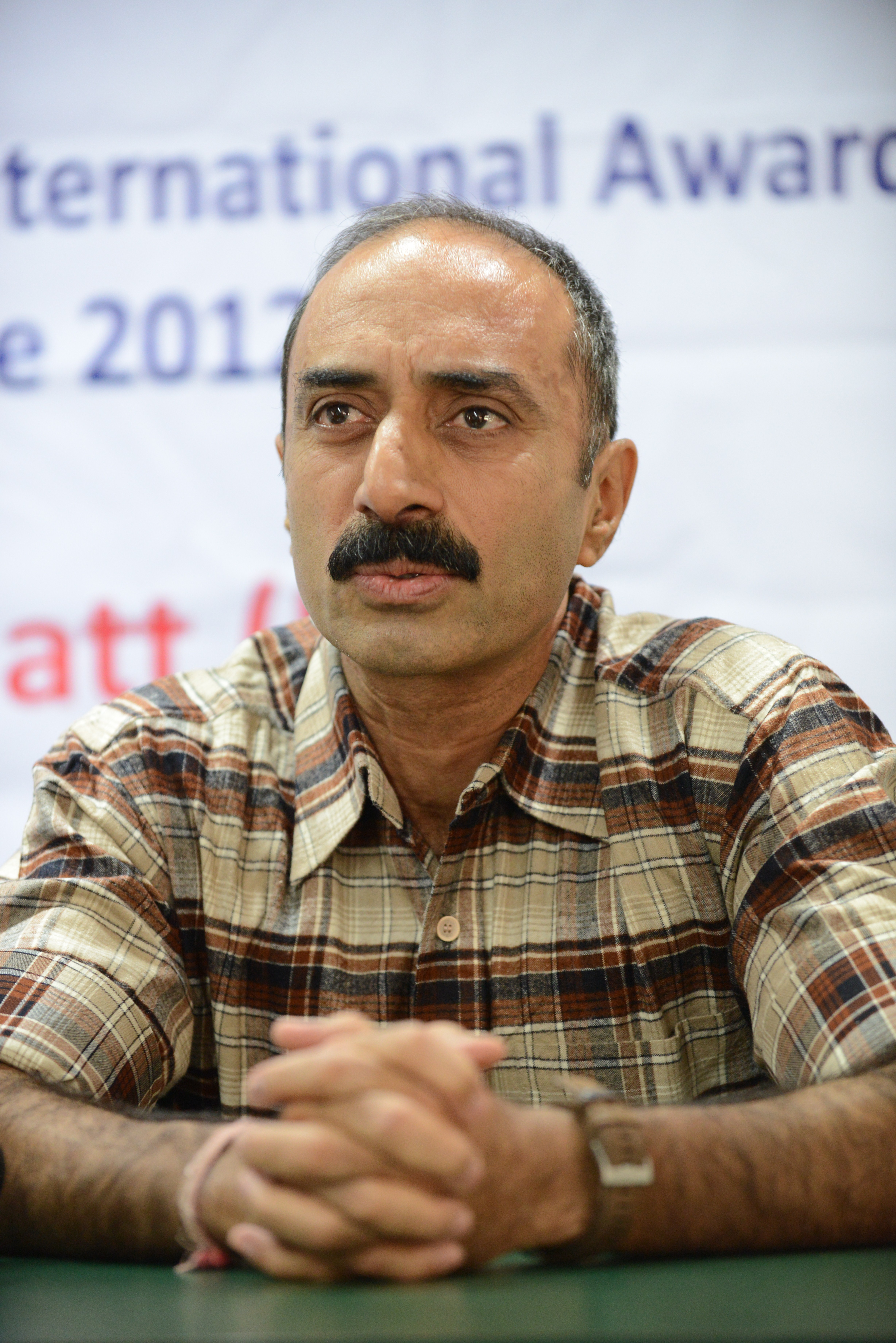Indian police officer Sanjiv Bhatt gestures after receiving the 5th Mother Teresa Award for Social Justice in Ahmedabad, India, on Dec. 31, 2012