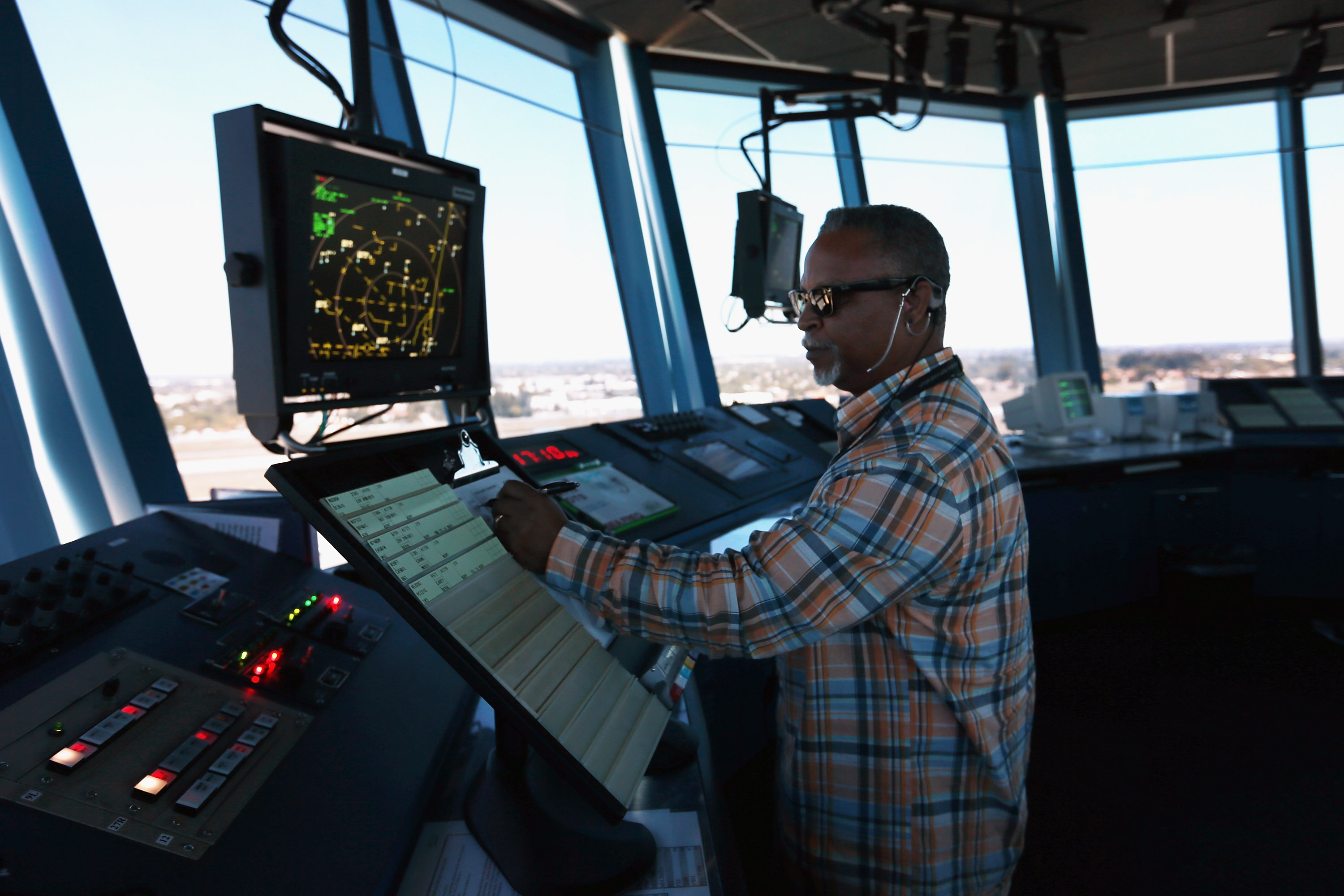 Air Traffic Controller, Robert Moreland, works in the control tower at Opa-locka airport on March 4, 2013 in Opa-locka, Florida.