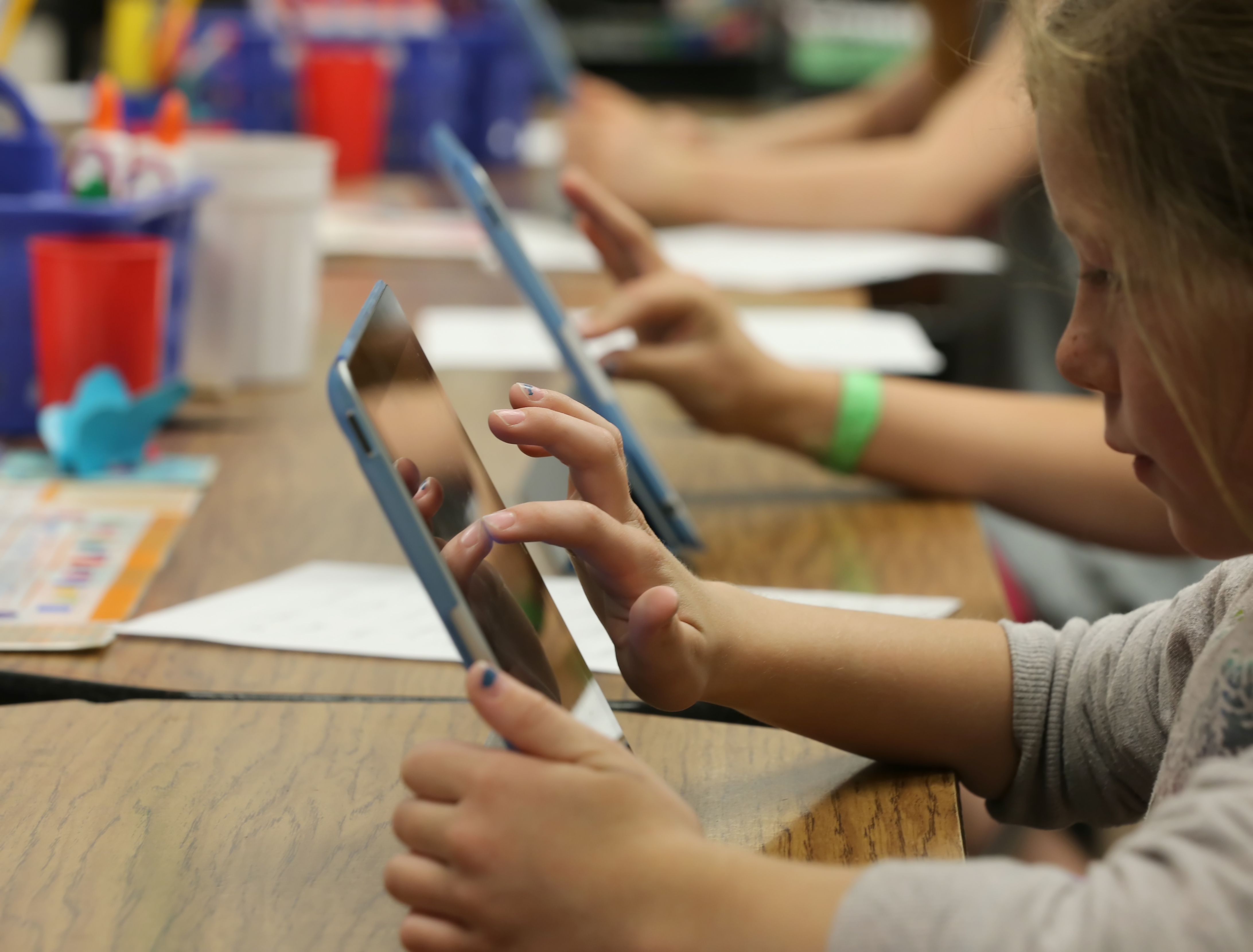 Second graders work on Apple Inc. iPads as part of their classroom work at Park Lane Elementary school, in the Canyons School District, in Sandy, Utah, U.S. on Monday, May 20, 2013.