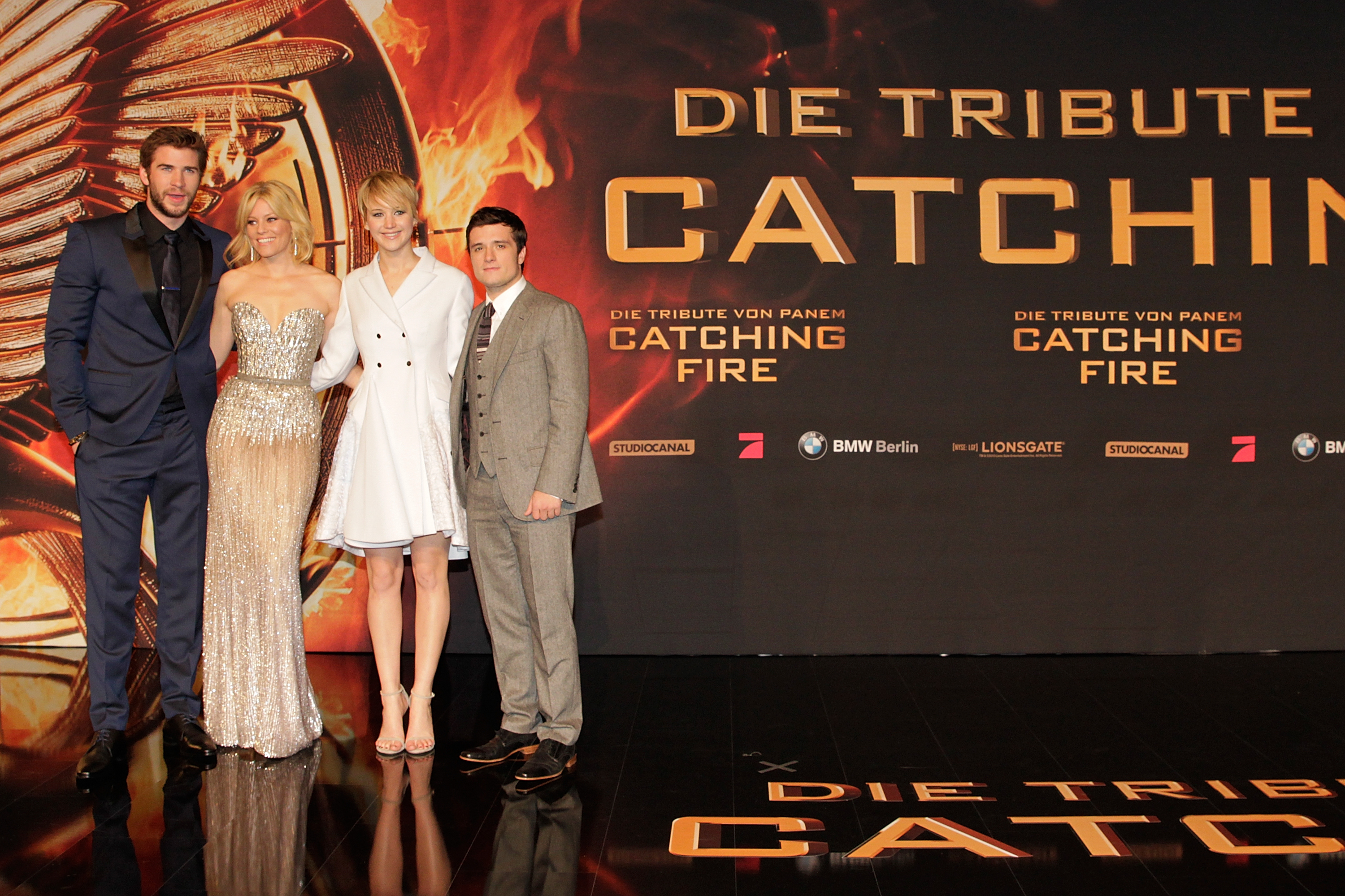 Liam Hemsworth, Elizabeth Banks, Jennifer Lawrence and Josh Hutcherson attend the German premiere of the film The Hunger Games - Catching Fire on Nov. 12, 2013 in Berlin.