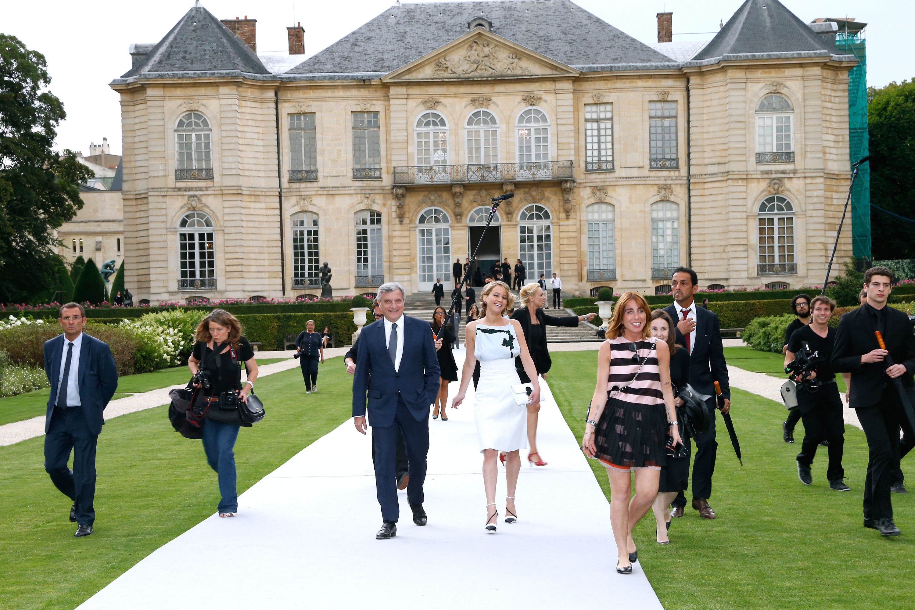 Sidney Toledano and Jennifer Lawrence attend the Christian Dior show as part of Paris Fashion Week - Haute Couture on July 7, 2014 in Paris.