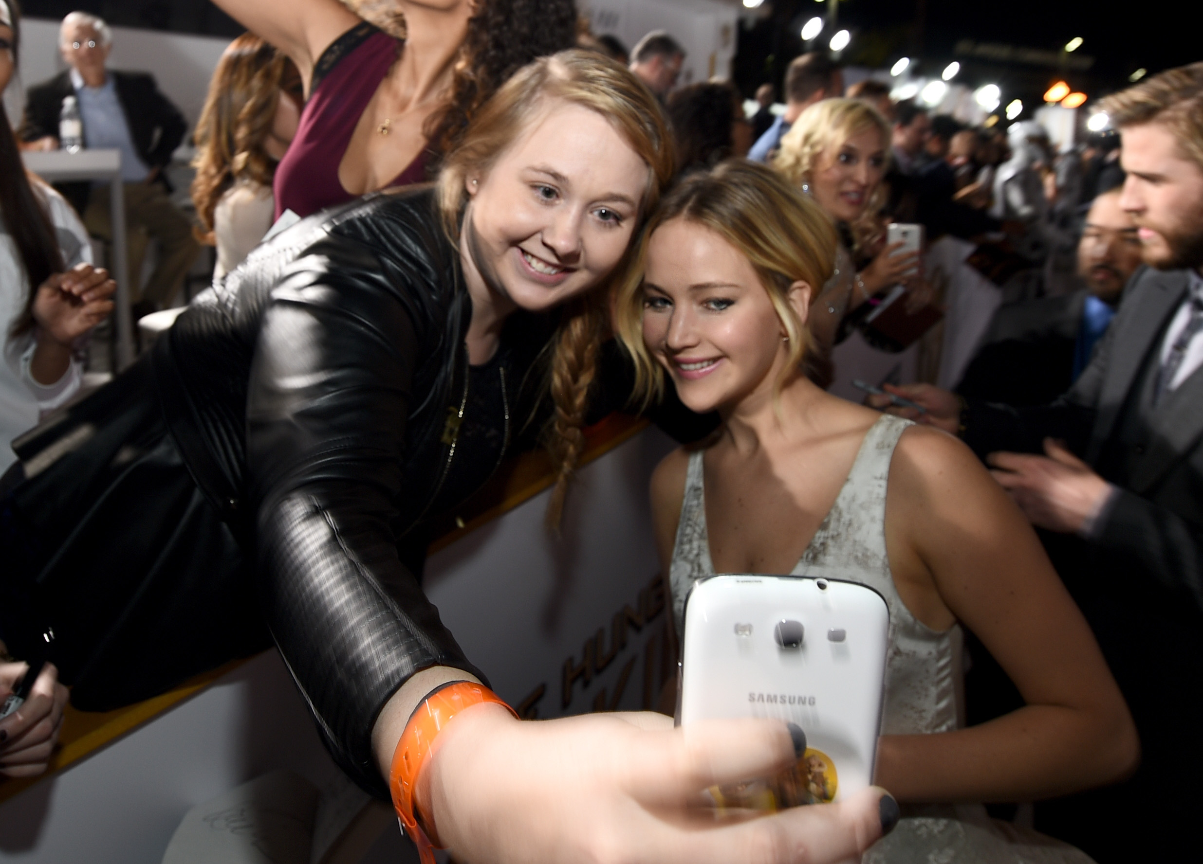 Fan Chelsea Boyce takes a selfie with  Jennifer Lawrence at the release of The Hunger Games: Mockingjay - Part 1 on Nov. 17, 2014 in Los Angeles.