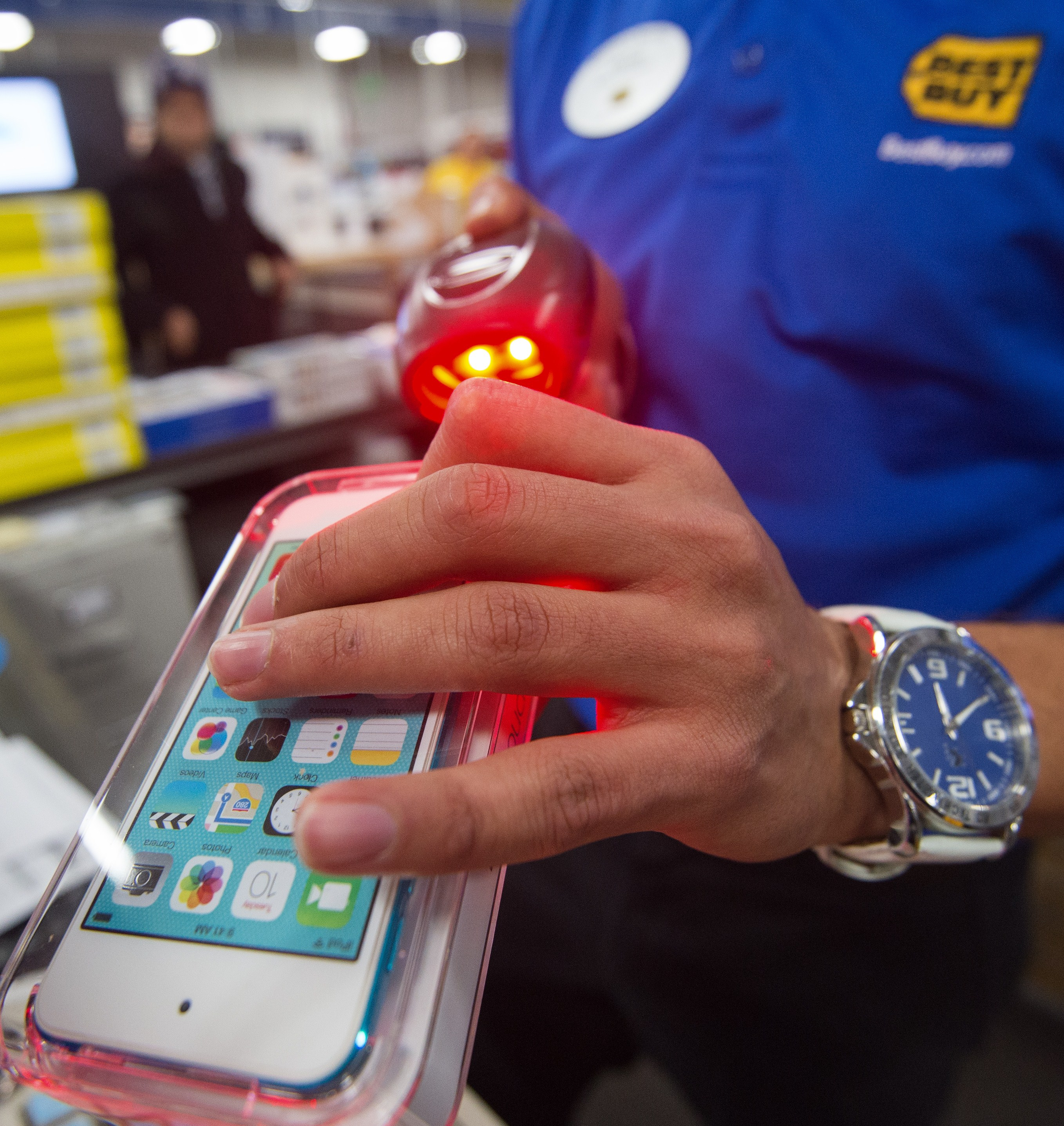 A salesperson scans an iPod Touch at the Best Buy store in Fairfax, Virginia on Nov. 27, 2014.