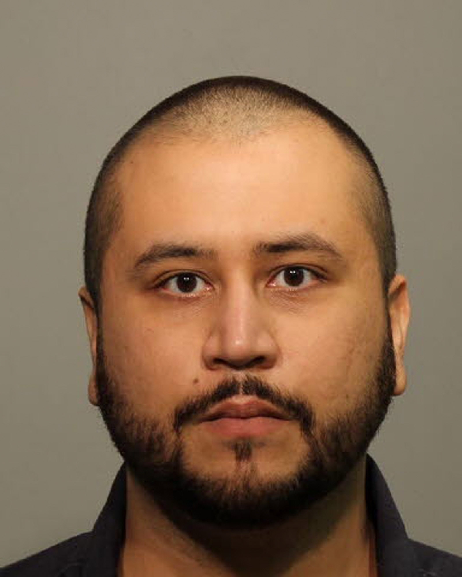 George Zimmerman poses for a mug shot photo after being arrested and booked into jail at the John Polk Correctional Facility in Sanford, Fla. on January 9, 2015.