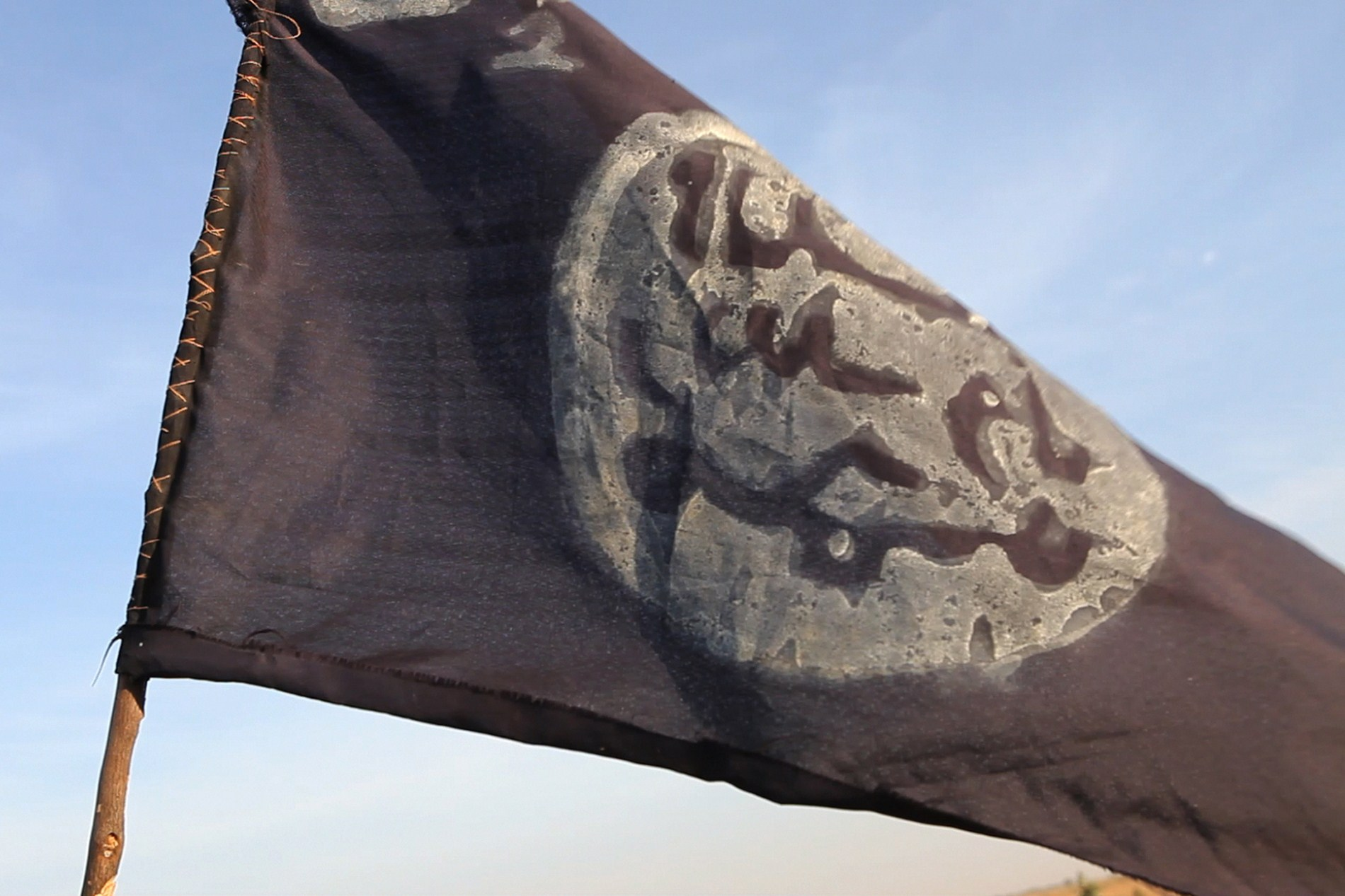 A Boko Haram flag flutters from an abandoned command post in Gamboru deserted after Chadian troops chased them from the border town on Feb. 4, 2015.