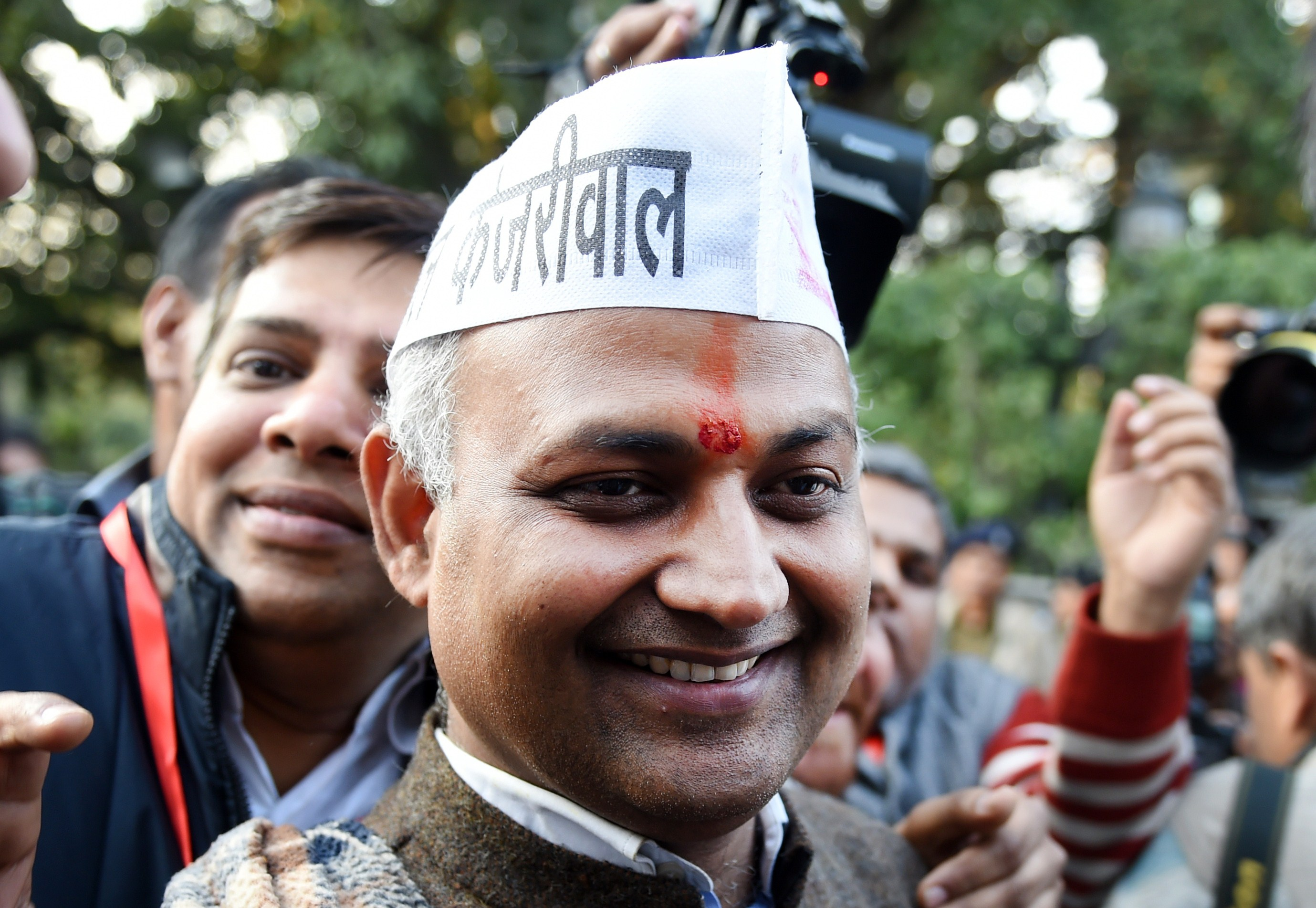 Senior Leader of India's Aam Aadmi Party (AAP) Somnath Bharti (C) arrives for a meeting in New Delhi on February 10, 2015.