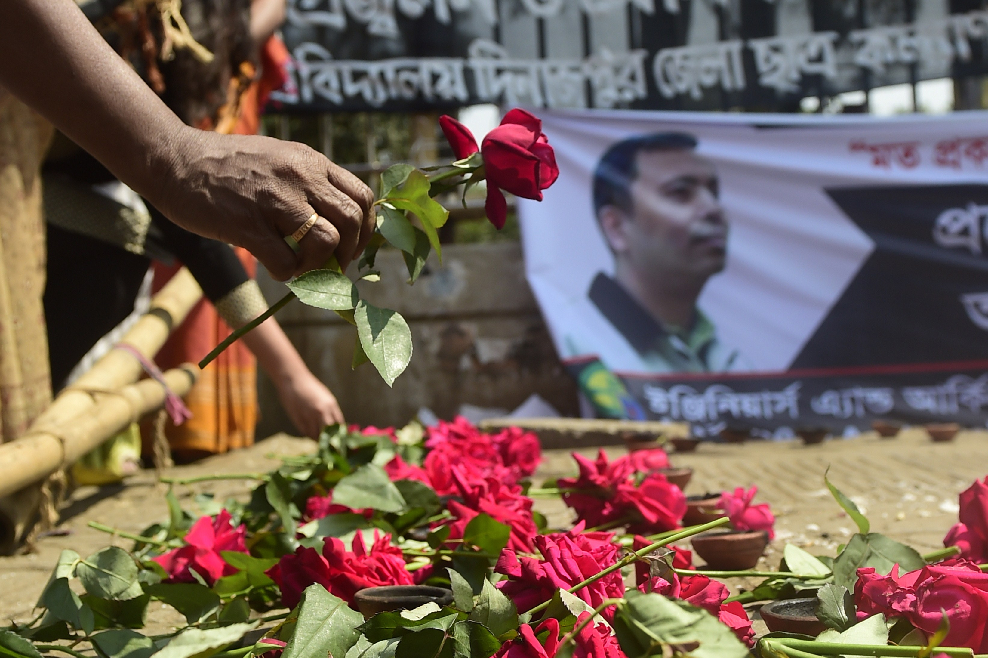 A Bangladeshi social activist pays his  last respects to slain US blogger of Bangladeshi origin and founder of the Mukto-Mona (Free-mind) blog site, Avijit Roy in Dhaka on March 6, 2015 after he was hacked to death by unidentified assailants in the Bangladeshi capital on February 26.