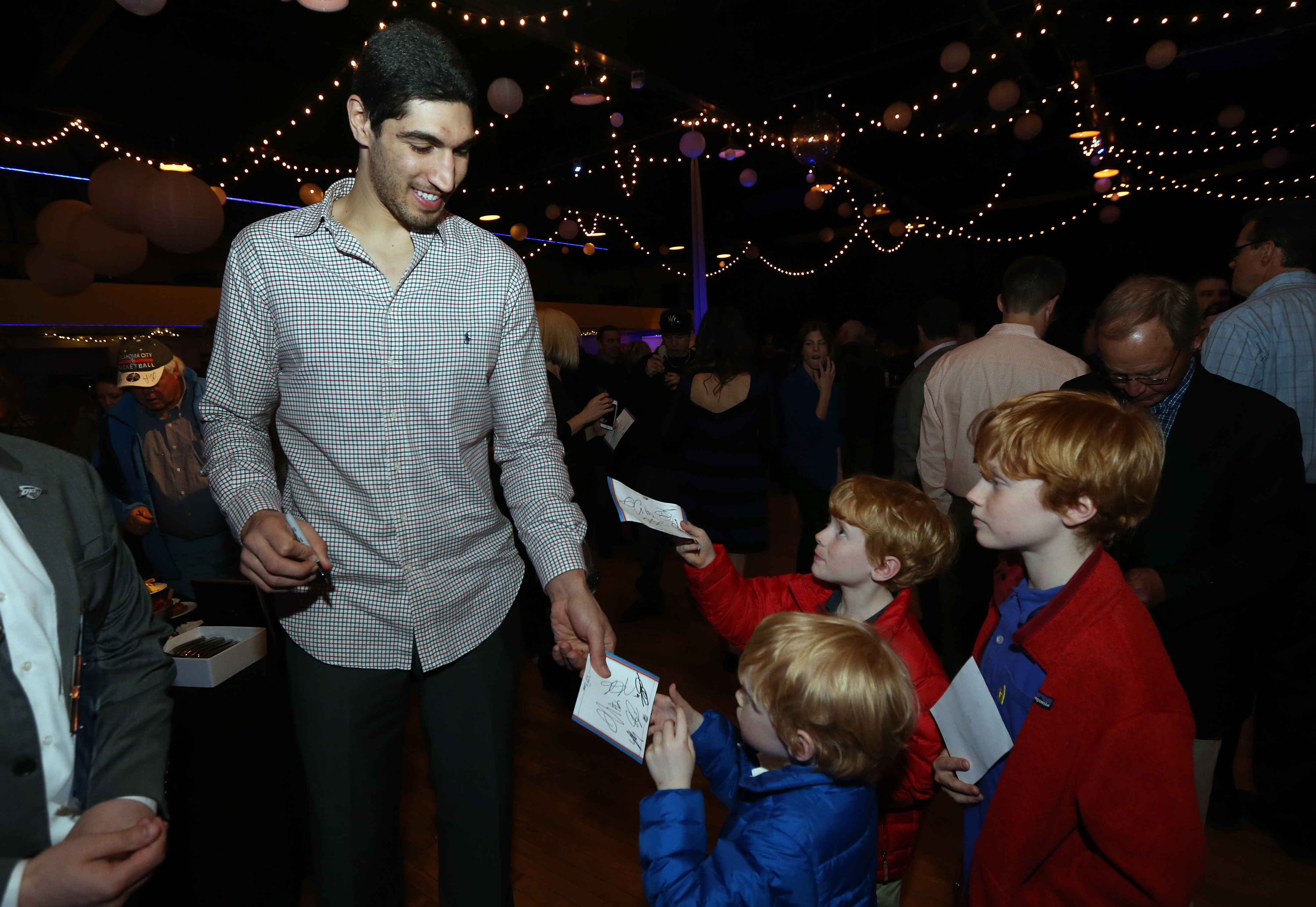 Enes Kanter #34 of the Oklahoma City Thunder signs autographs for fans at a Thunder Season ticket holder VIP event on March 3, 2015 at the Oklahoma City Farmers Market in Oklahoma City, Oklahoma.