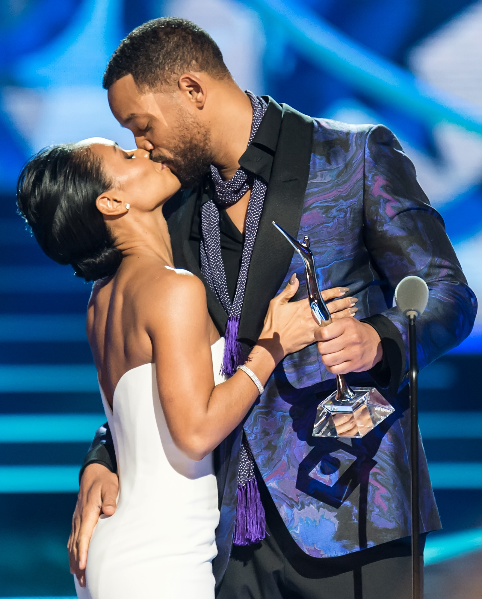 Actor Will Smith (R) presents his wife, actress Jada Pinkett Smith with the Star Power award  onstage during 2015 'Black Girls Rock!' BET Special at NJ Performing Arts Center on March 28, 2015 in Newark, New Jersey.