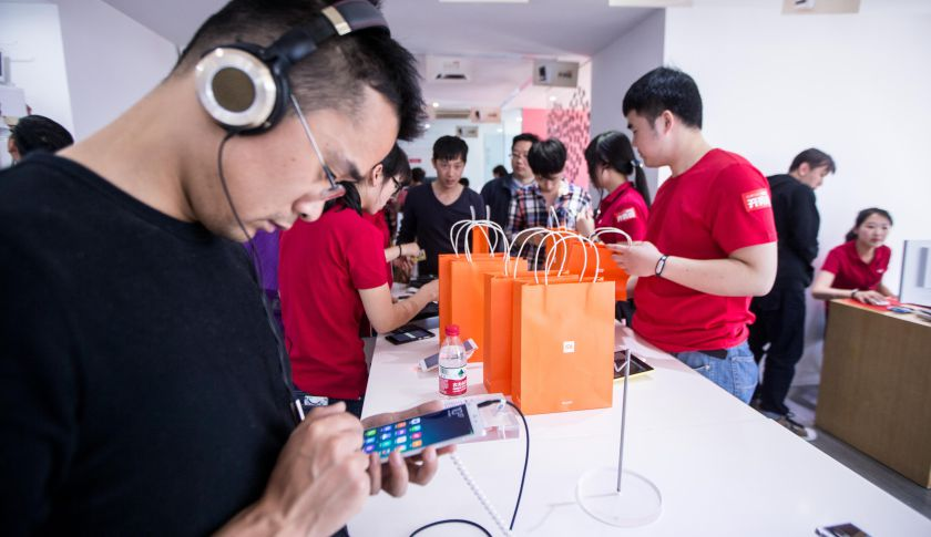 Customers look at Xiaomi phones at a Xiaomi experience store on May 12, 2105 in Hangzhou, Zhejiang province of China.