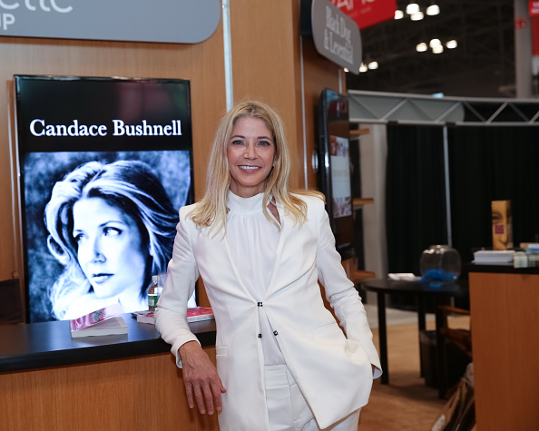 Author Candace Bushnell poses for photographs with her newest book during BookCon held at the Javits Center on May 31, 2015 in New York City