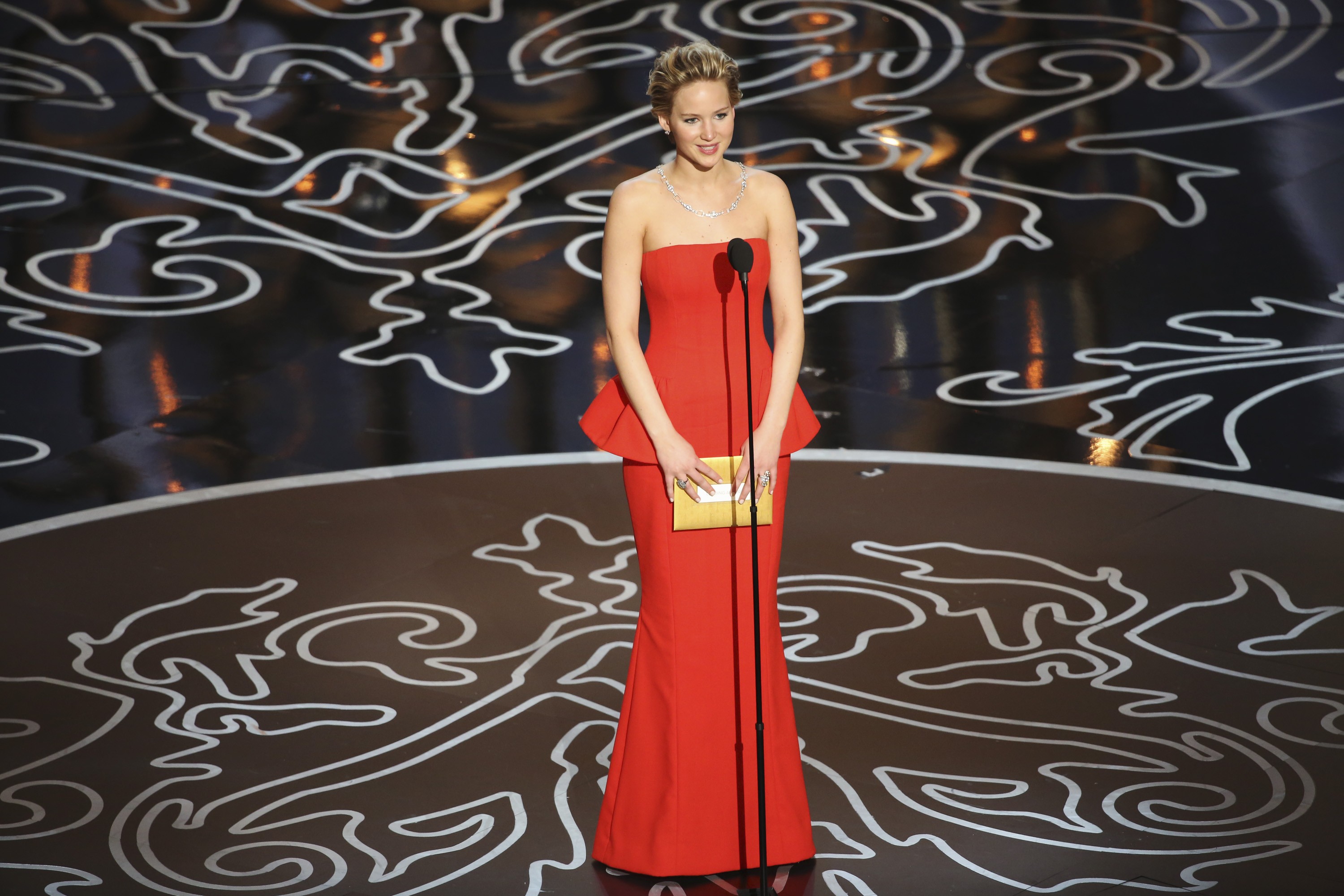Jennifer Lawrence presents the Best Actor category at the 86th Academy Awards on March 2, 2013 in Los Angeles.