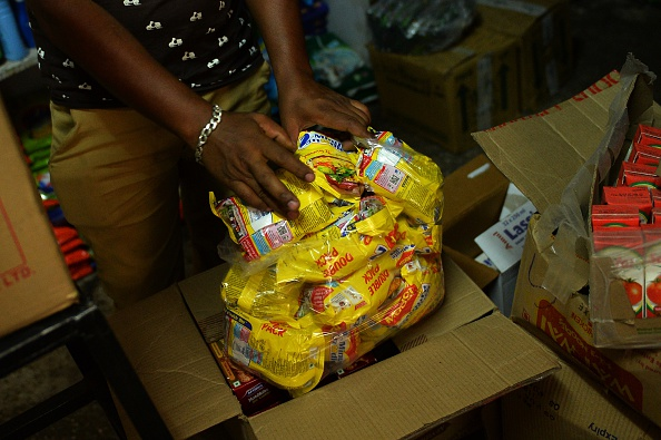 A shopkeeper puts packs of Nestle 'Maggi' instant noodles into a plastic bag in his shop in New Delhi, India, June 17, 2015