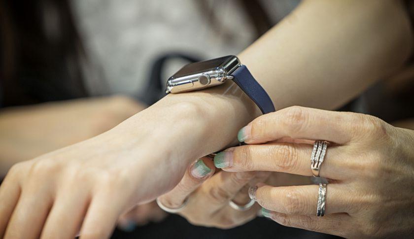 A customer tries on an Apple Watch.