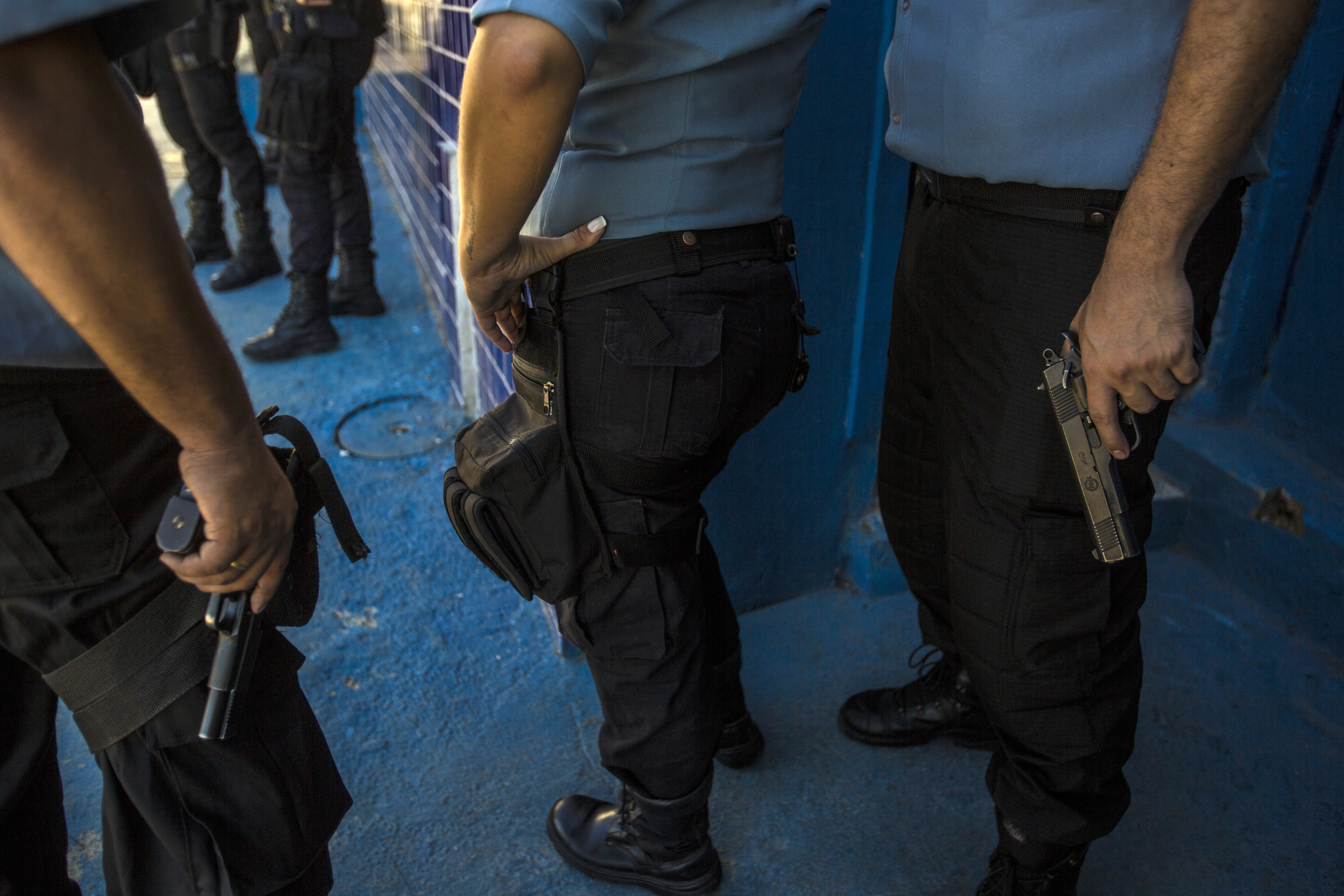 Armed officers from the Pacifying Police Unit (UPP) patrol in the Providencia favela of Rio de Janeiro, Brazil, on Monday, June 22, 2015.