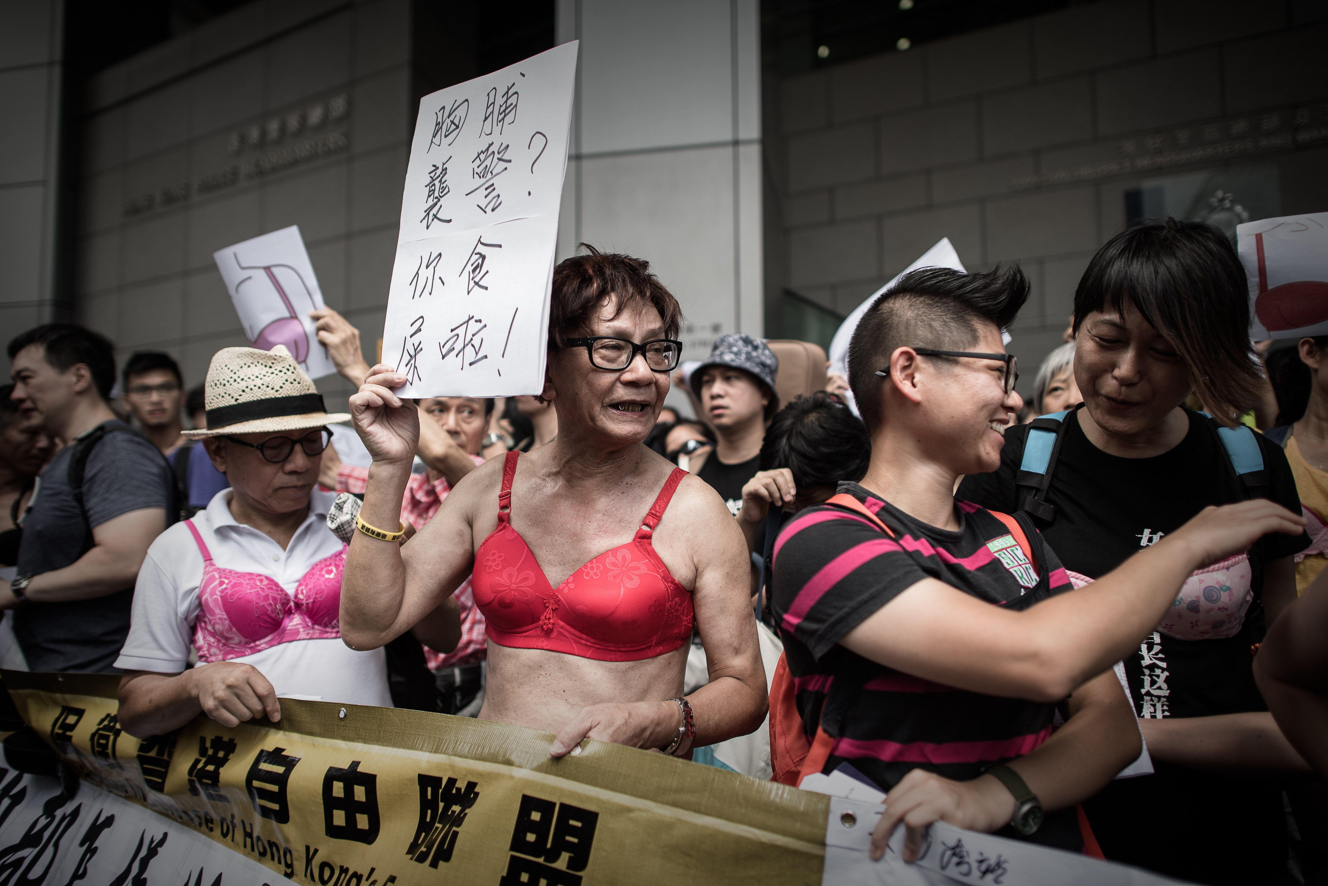 Protesters wear bras during a demonstration outside the police headquarters in Hong Kong on August 2, 2015.