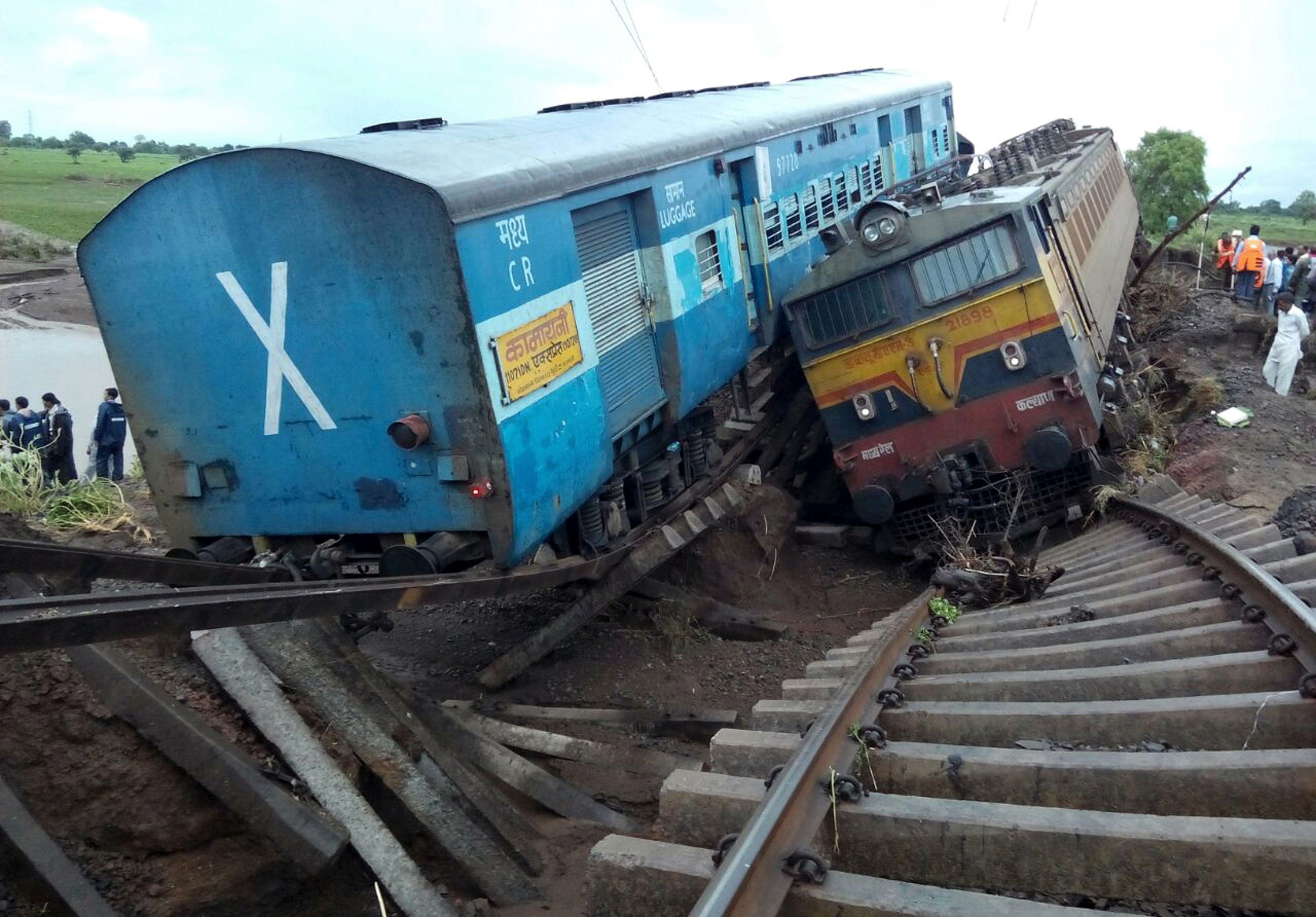 Two Indian passenger trains lay next to each other following a derailment after they were hit by flash floods on a bridge outside the town of Harda in Madhya Pradesh state on August 5, 2015