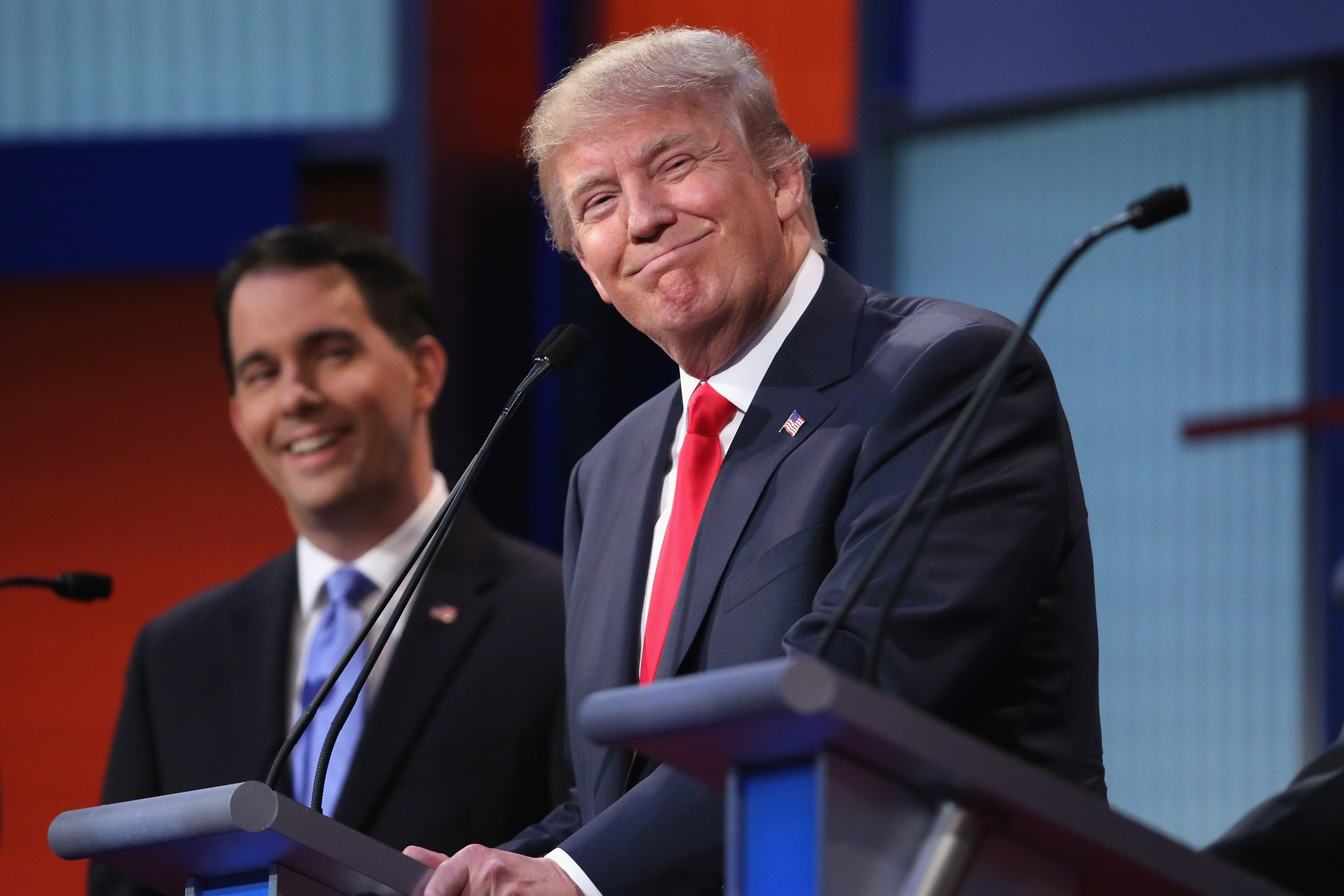 Republican presidential candidates Donald Trump (R) and Wisconsin Gov. Scott Walker participate in the first prime-time presidential debate hosted by FOX News and Facebook at the Quicken Loans Arena August 6, 2015 in Cleveland, Ohio.