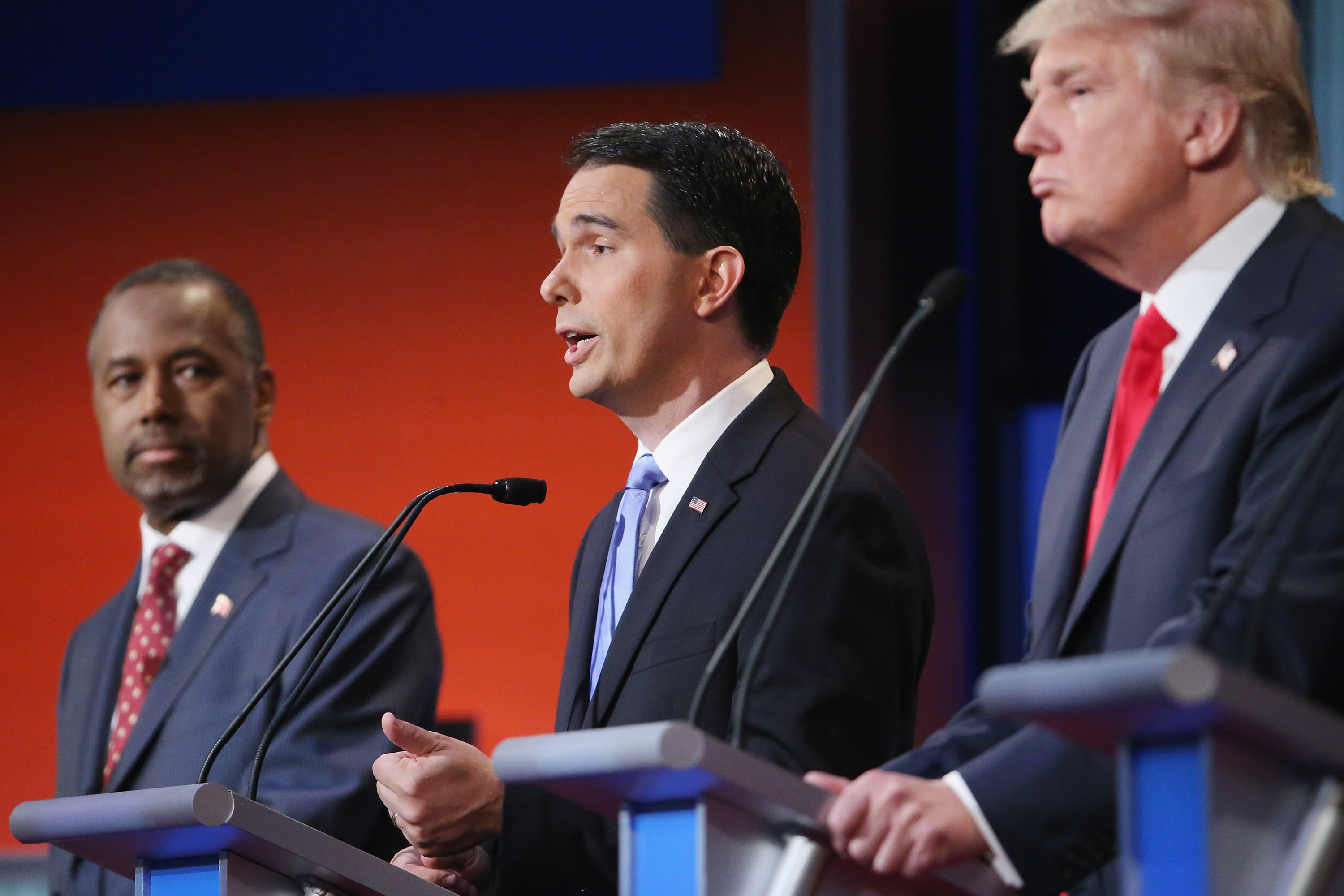 Republican presidential candidates (L-R) Ben Carson, Wisconsin Gov. Scott Walker and Donald Trump participate in the first prime-time presidential debate hosted by FOX News and Facebook at the Quicken Loans Arena August 6, 2015 in Cleveland, Ohio.