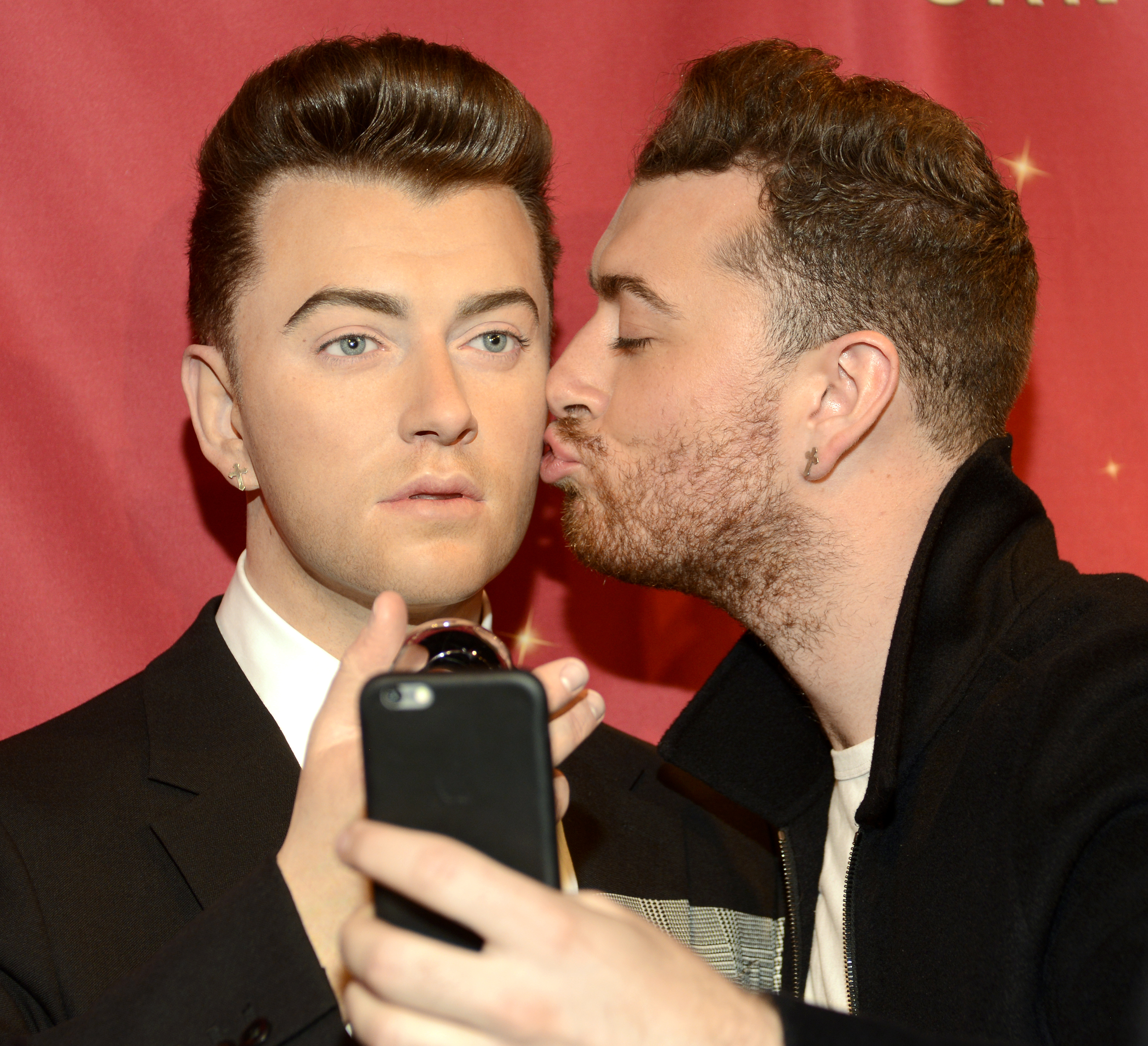 Sam Smith with is wax figurine at Madame Tussauds San Francisco on Aug.10, 2015 in San Francisco.