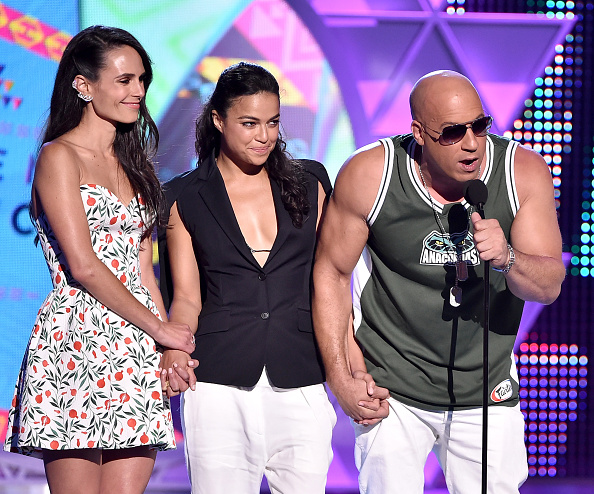 Actors Jordana Brewster, Michelle Rodriguez and Vin Diesel, left to right, accept the Choice Movie: Action Award for Furious 7 onstage during the Teen Choice Awards 2015 at the USC Galen Center on Aug. 16, 2015, in Los Angeles, Calif.