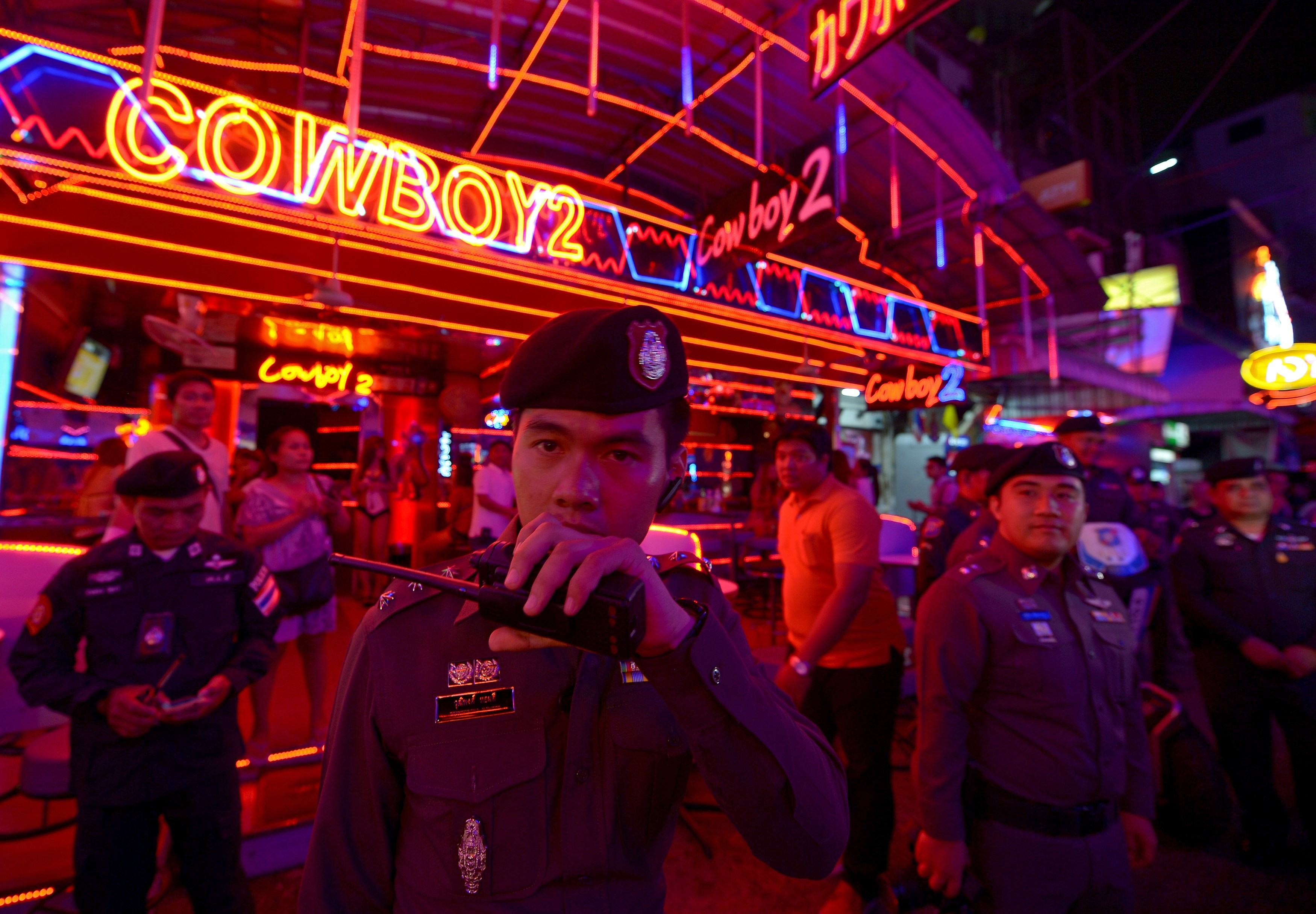Thai policemen check security at bars in the tourist area of Bangkok on August 19, 2015.