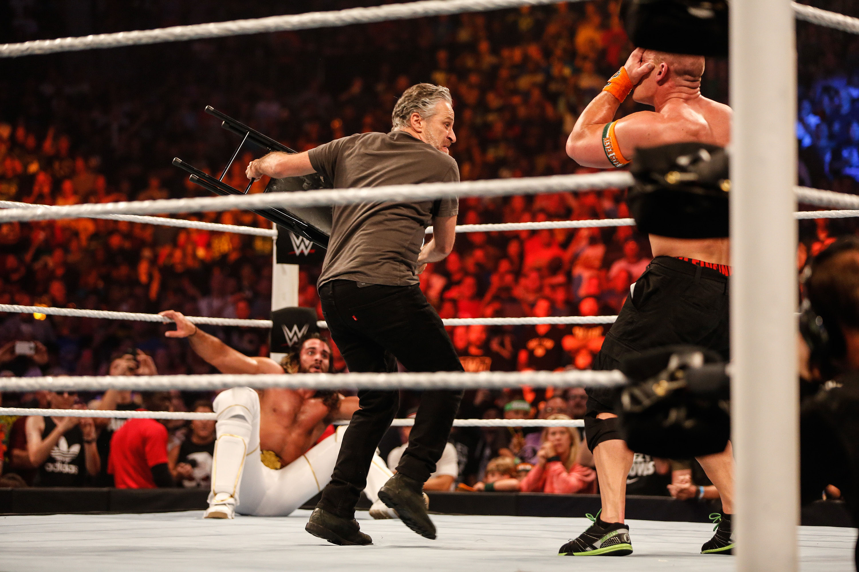 Jon Stewart gets into the action at WWE SummerSlam 2015 Barclays Center of Brooklyn in New York City on Aug. 23, 2015.