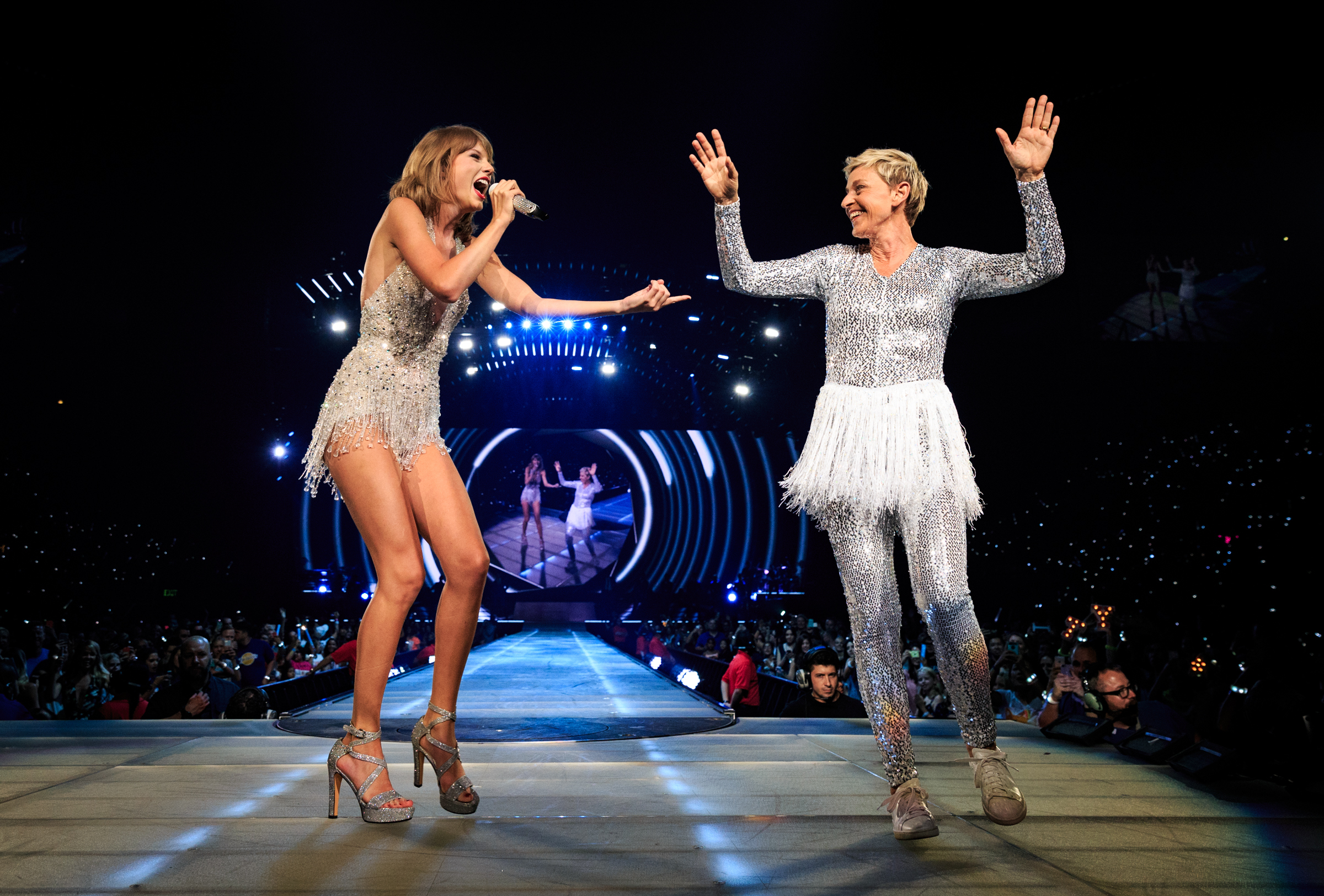 Singer-songwriter Taylor Swift and comedian Ellen DeGeneres perform onstage during Taylor Swift The 1989 World Tour Live In Los Angeles at Staples Center on August 24, 2015.