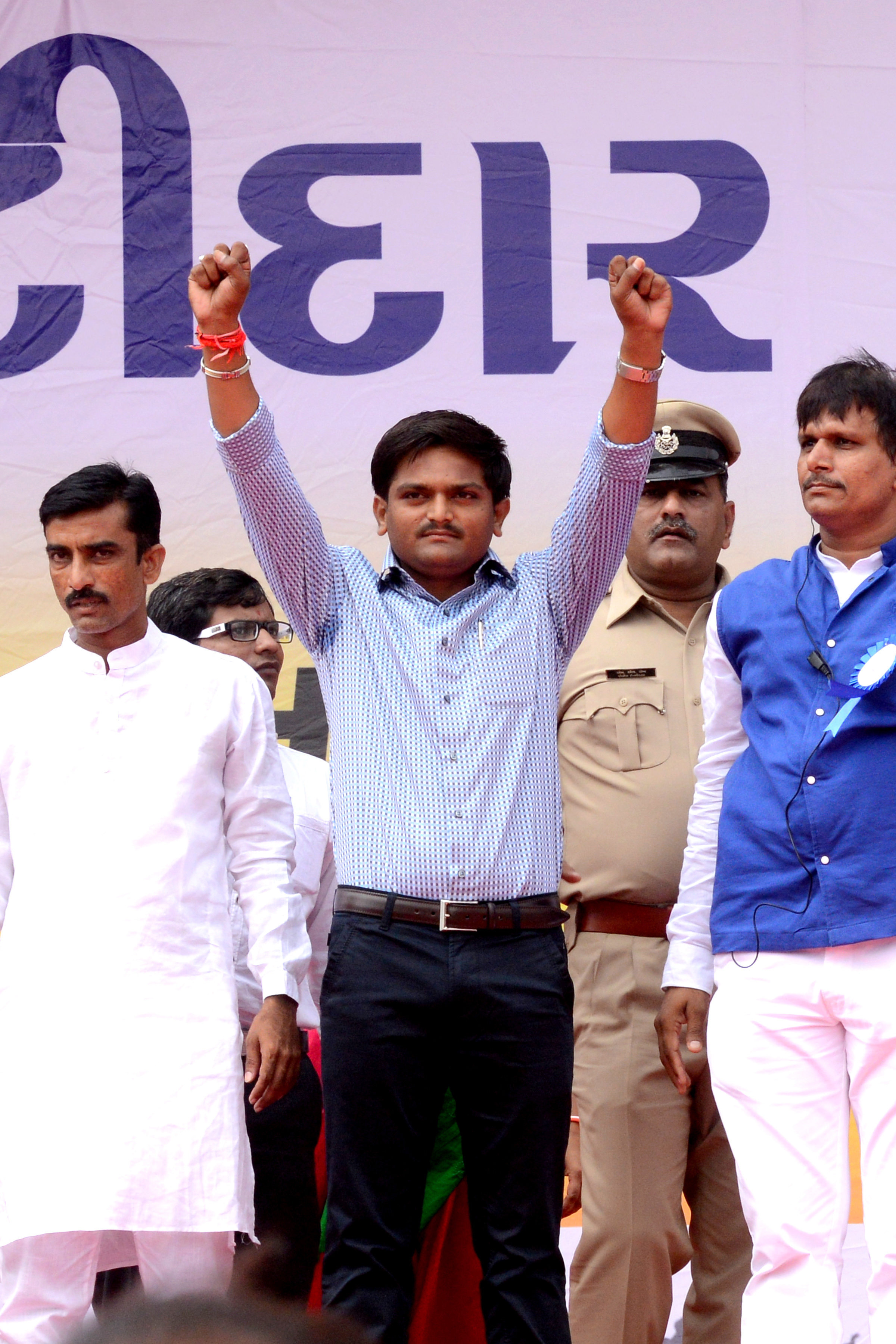 Hardik Patel, center, and others at the Maha Kranti rally at GMDC ground in Ahmedabad on Aug. 25, 2015. The Maha Kranti rally comes after a monthlong agitation by the Patel community for their demand of reservation