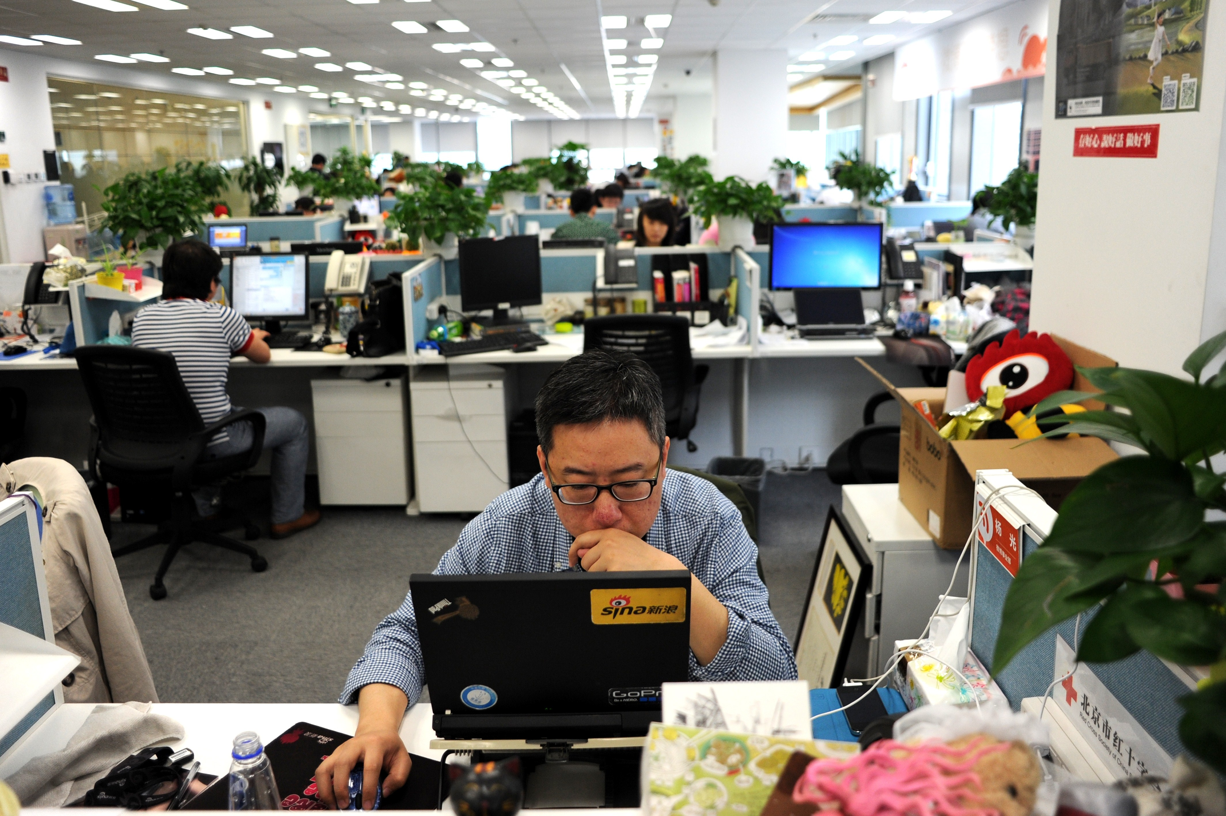 This picture taken on April 16, 2014 shows a man using a laptop at an office of Sina Weibo, widely known as China's version of Twitter, in Beijing.